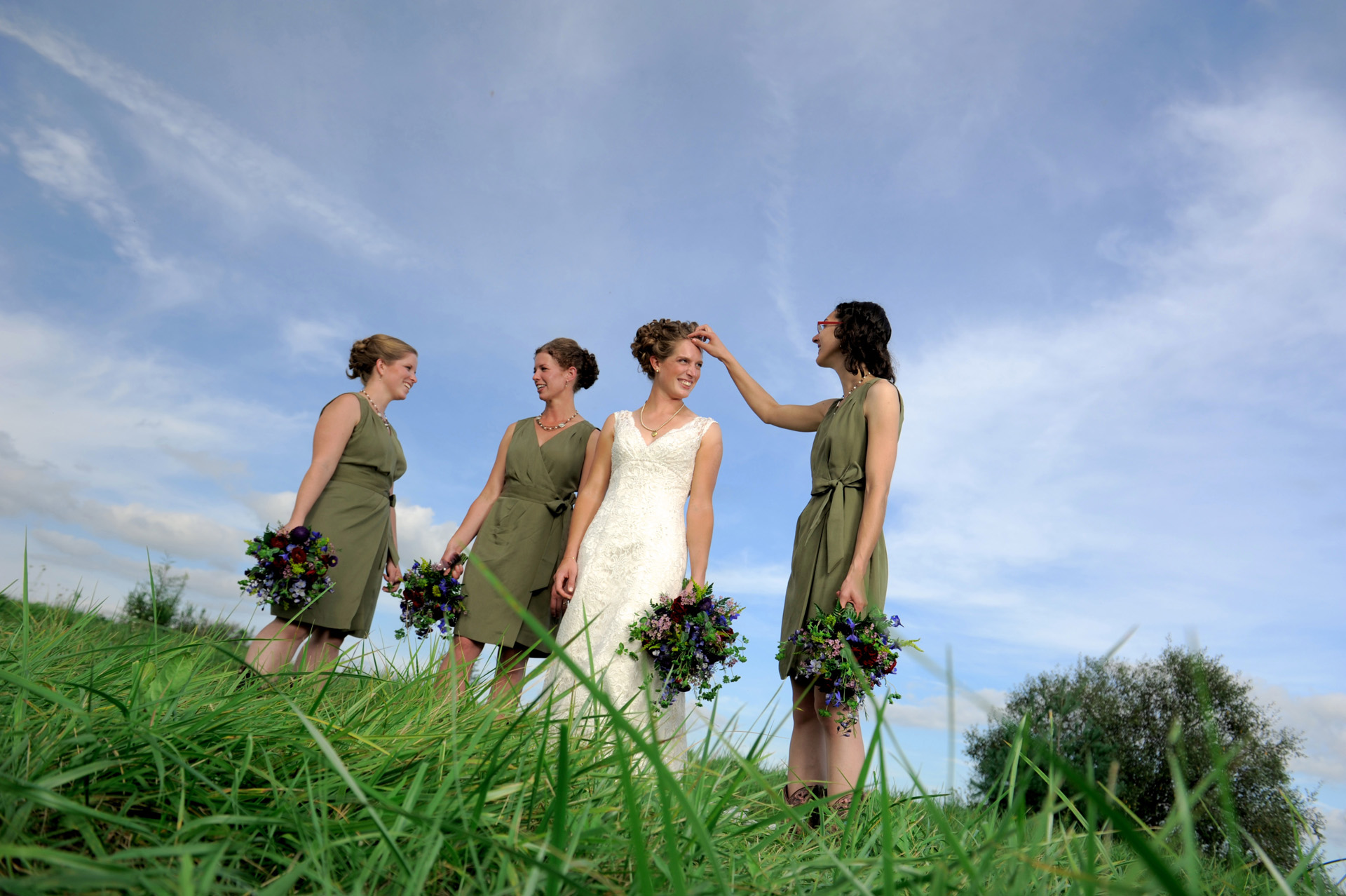 Michigan country wedding wedding photographer captures a candid moment of the bridesmaids during the Michigan country wedding.