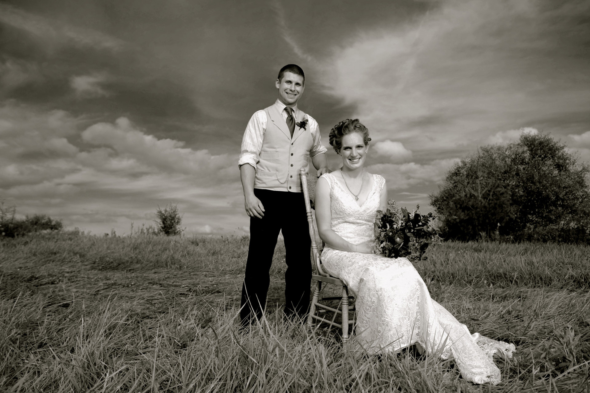 Michigan country wedding wedding photographer's photo of the bride and groom pose for an old fashioned portrait at their Michigan country wedding.