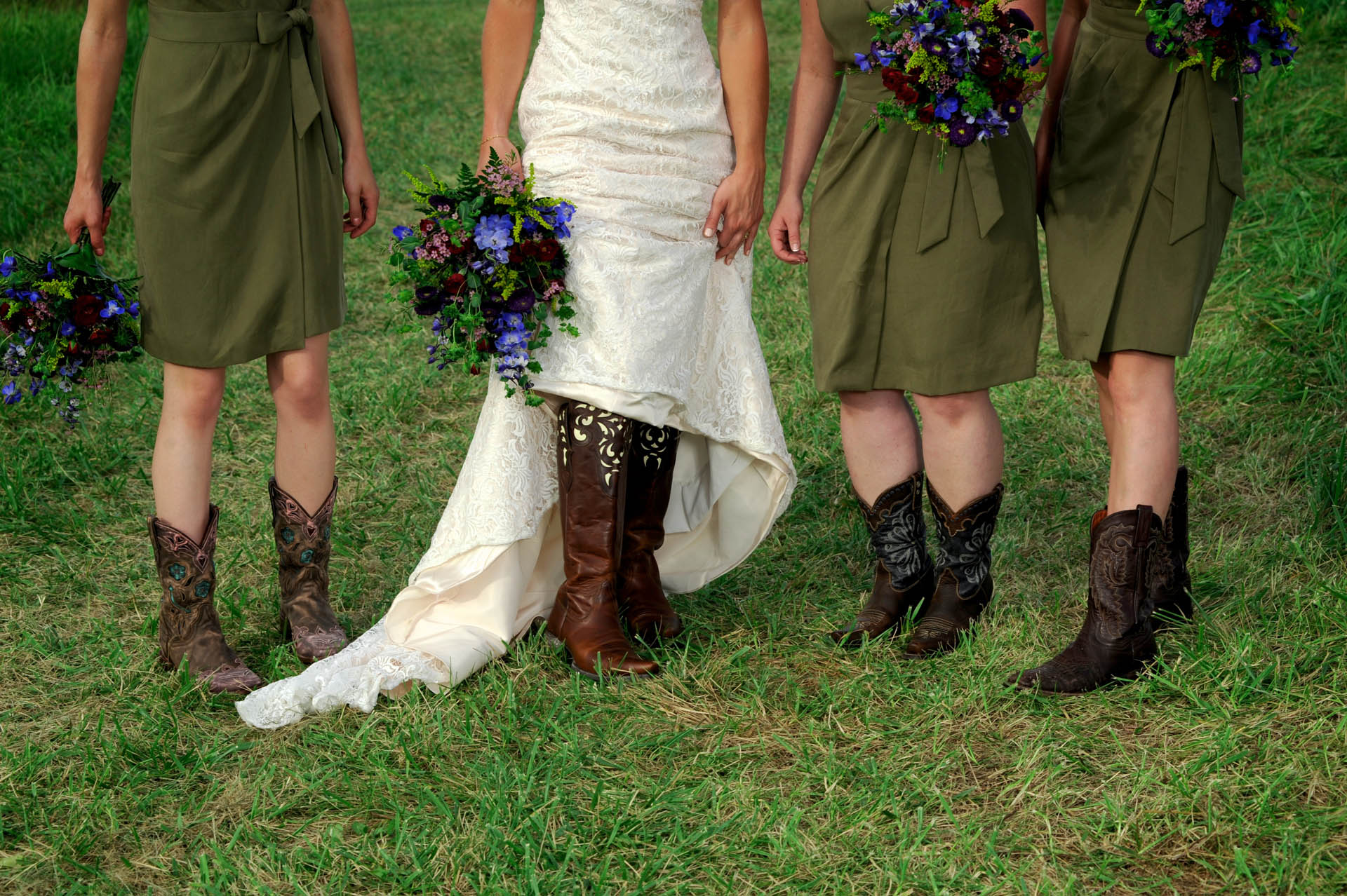 Michigan country wedding wedding photographer shoots the cowboy boots on the bridesmaids during a farm Michigan country wedding.