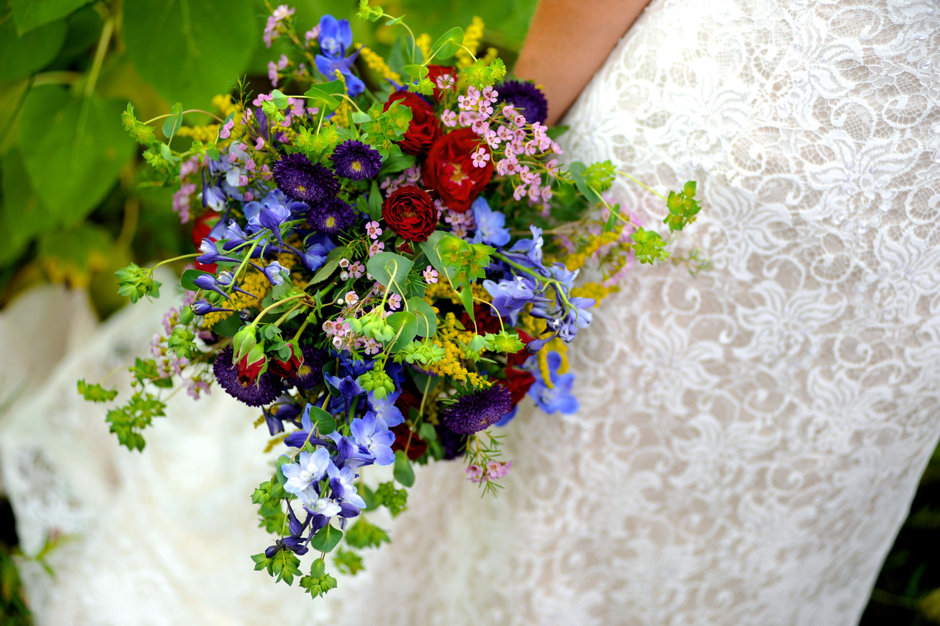 Michigan country wedding wedding photographer's photo of the bride's bouquet of wildflowers at the Michigan country wedding.