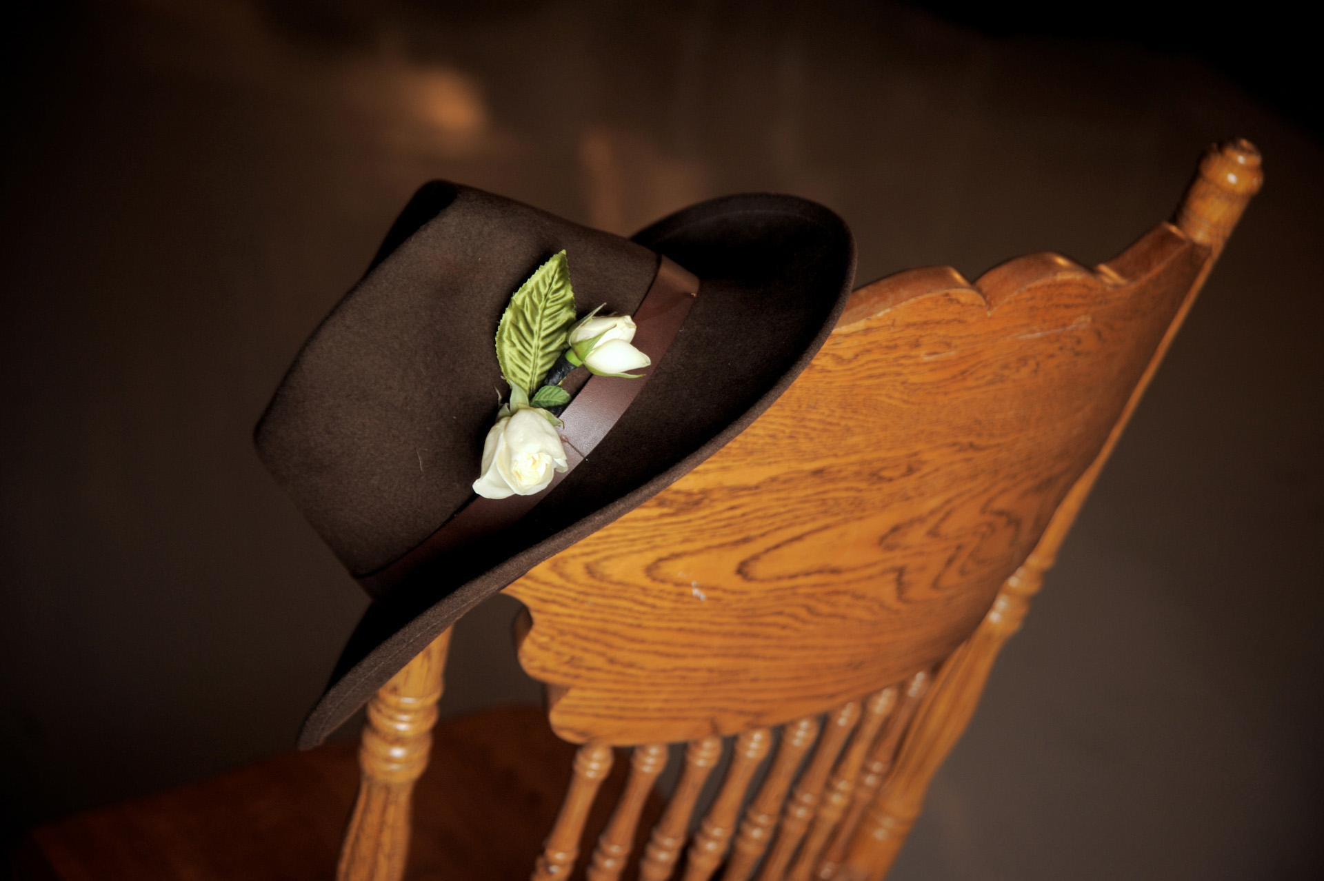 Michigan country wedding wedding photographer's photo of a cowboy hat on a chair towards the end of the night at a Michigan country wedding.