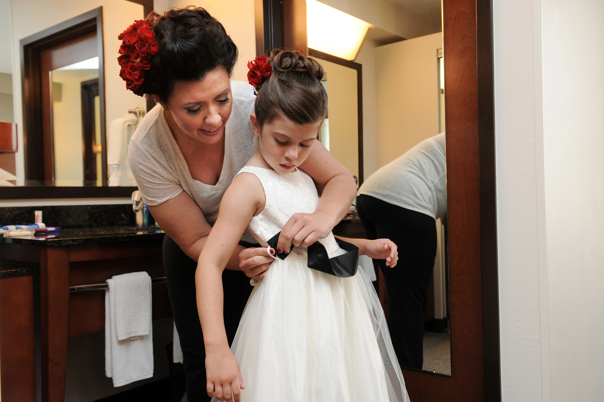Livonia, Michigan wedding photographer's photo of the bride helps her daughter get ready for her wedding at the Michigan same sex wedding.
