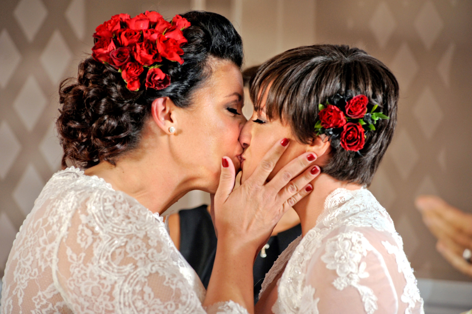 Michigan same sex wedding wedding photographer's photo of the brides kissing after their same sex wedding in Livonia, Michigan!