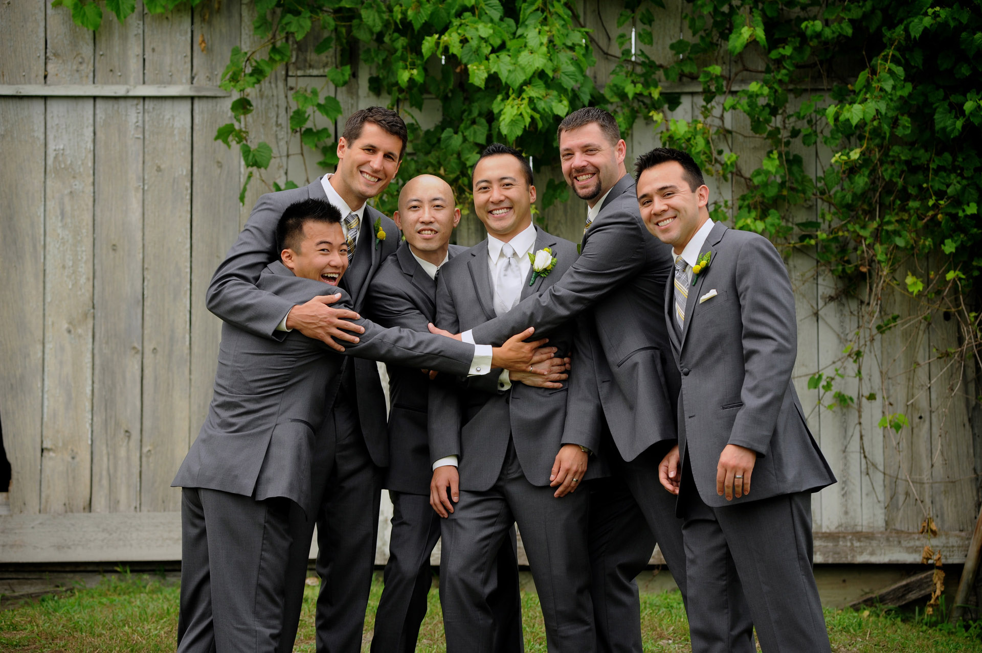 Pine Trace Golf Club wedding photographer's photo of the groom and groomsmen goofing off before their Troy , Michigan wedding.