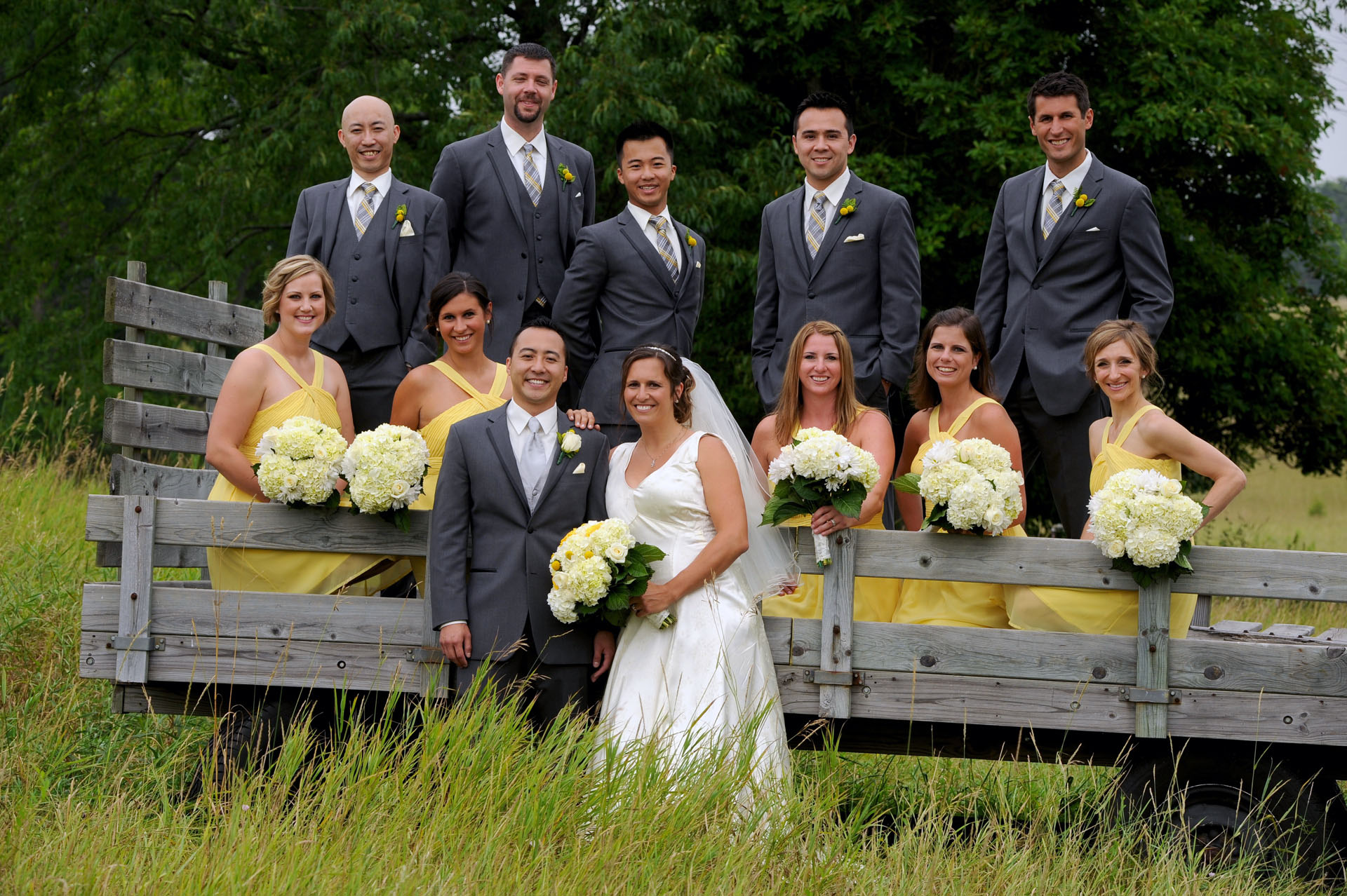 Pine Trace Golf Club wedding photographer's photo of the bridal party goofing around in Troy, Michigan.