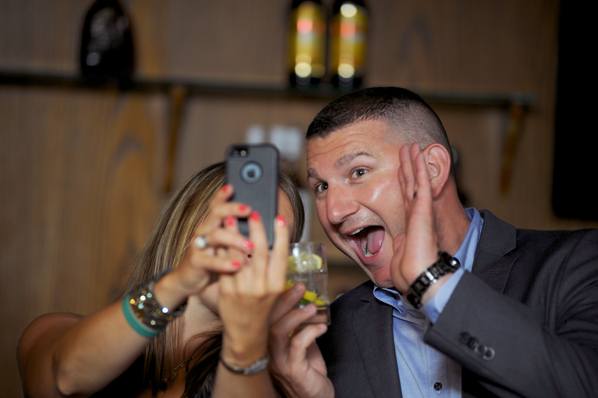 Pine Trace Golf Club wedding photographer's photo of several guests taking selfless at the Pine Trace Golf Club.