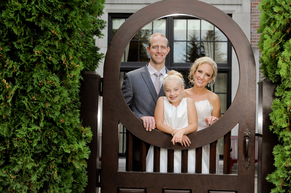 A Rochester, Michigan wedding features a couple and their daughter at their Royal Park Hotel wedding in Rochester, Michigan.
