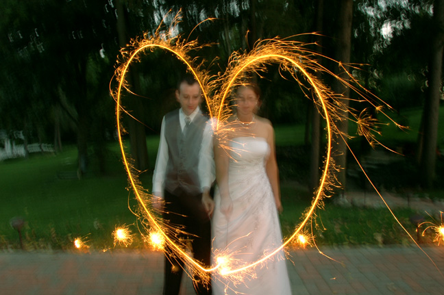Michigan wedding photographer takes photos of the bride and groom making a heart with sparklers after their English Inn wedding