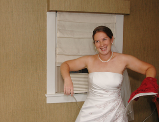 Michigan wedding photographer captures a bride getting the most out of air conditioning before her Lansing, MI wedding