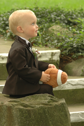 Michigan wedding photographer captures a ringbearer waiting for instructions before a Lansing, MI wedding