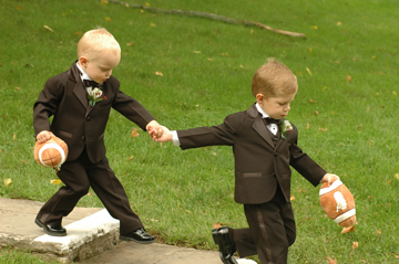 Michigan wedding photojournalist takes candid photos of cute kids during all her Michigan weddings