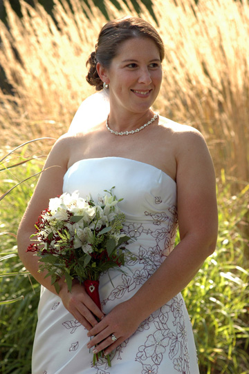 Wedding photographer in MI loves this natural shot of Amanda in the tall fall grass near Lansing Mich