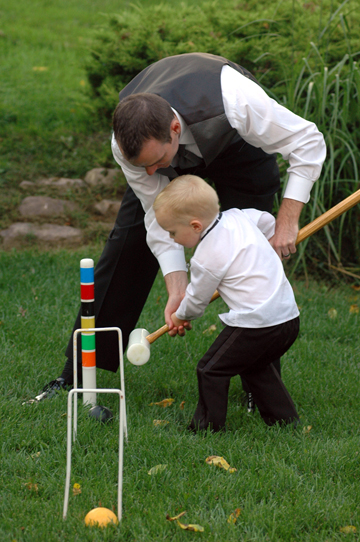 Wedding photojournalist Marci Curtis's  croquet photo taken during the wedding reception at the English Inn in Michigan