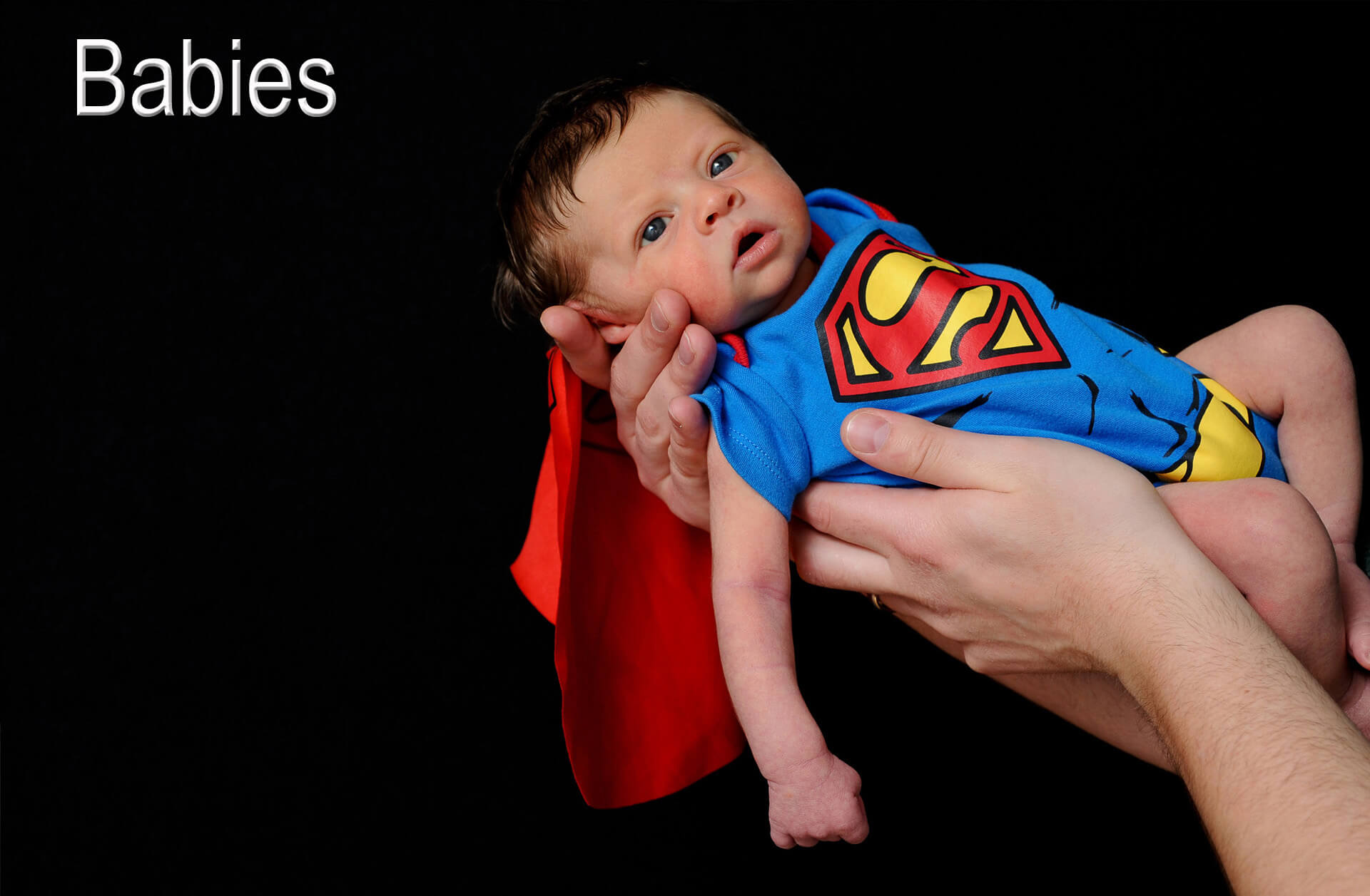 A super baby was born in the metro Detroit, Michigan area as this babe poses at the Troy studio in his Superman baby outfit.