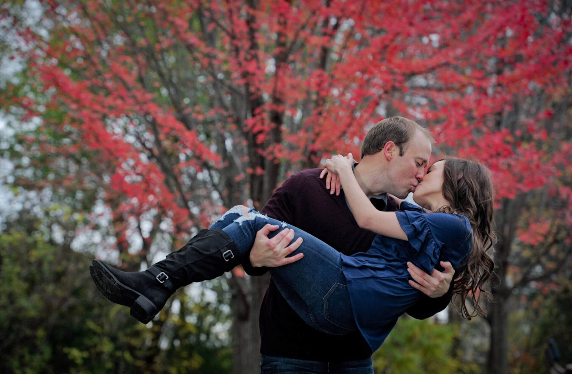A Lansing, Michigan couple kiss to stay warm during this chilly engagement photo session in Auburn Hills, Michigan.
