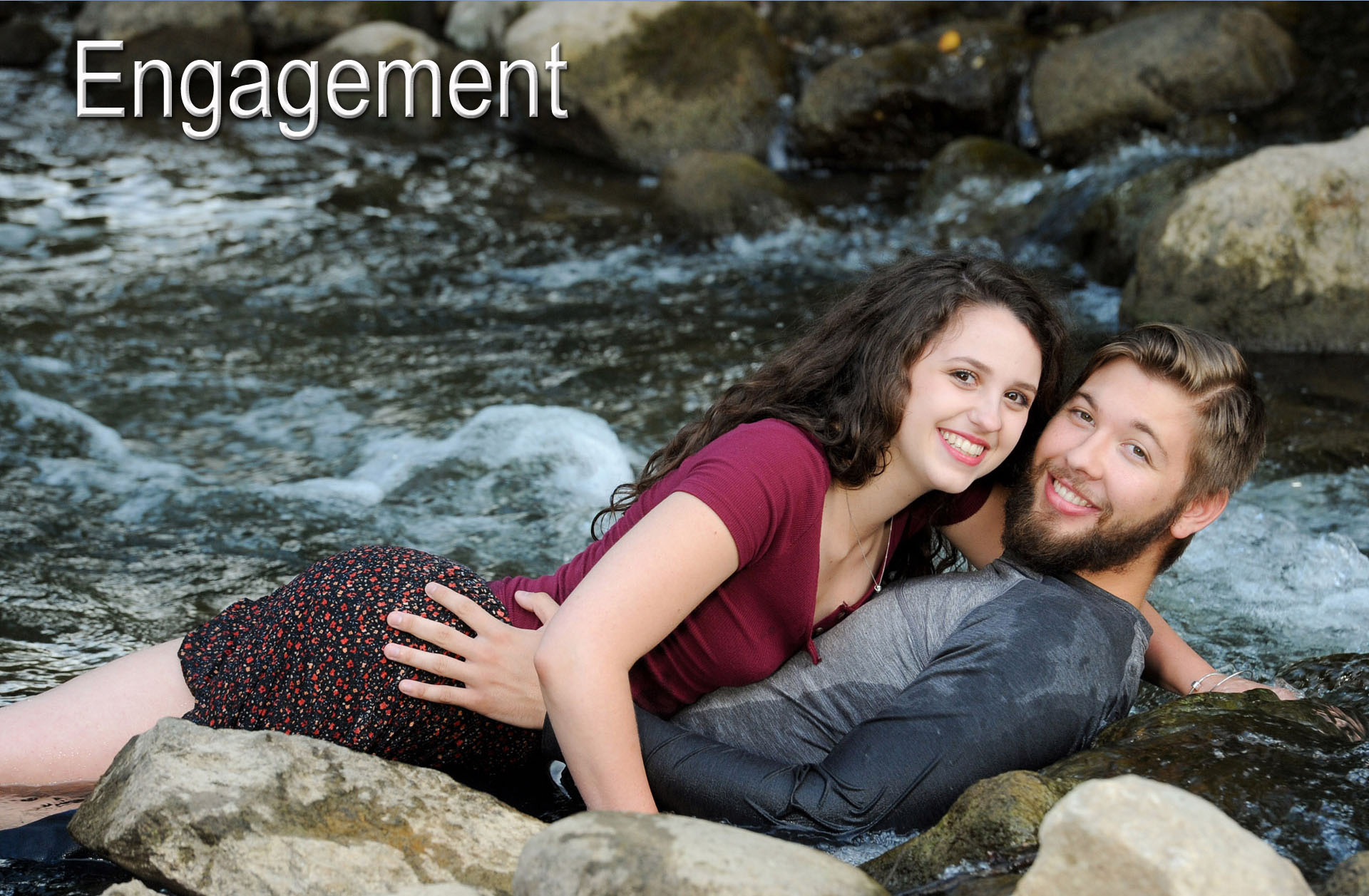 An engaged couple frolic in the water in Rochester, Michigan.