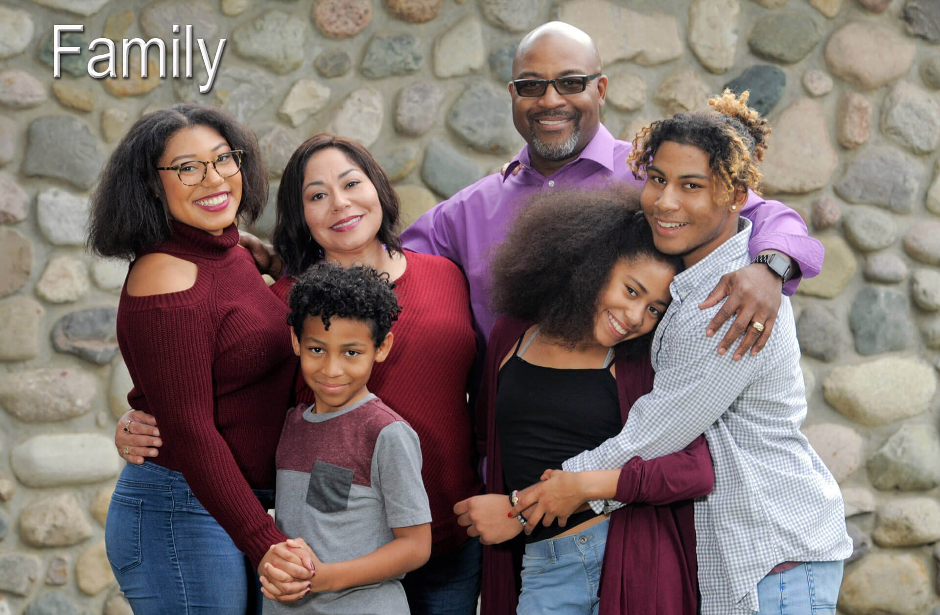 A family cuddles for this fun family photo in Auburn Hills, Michigan.