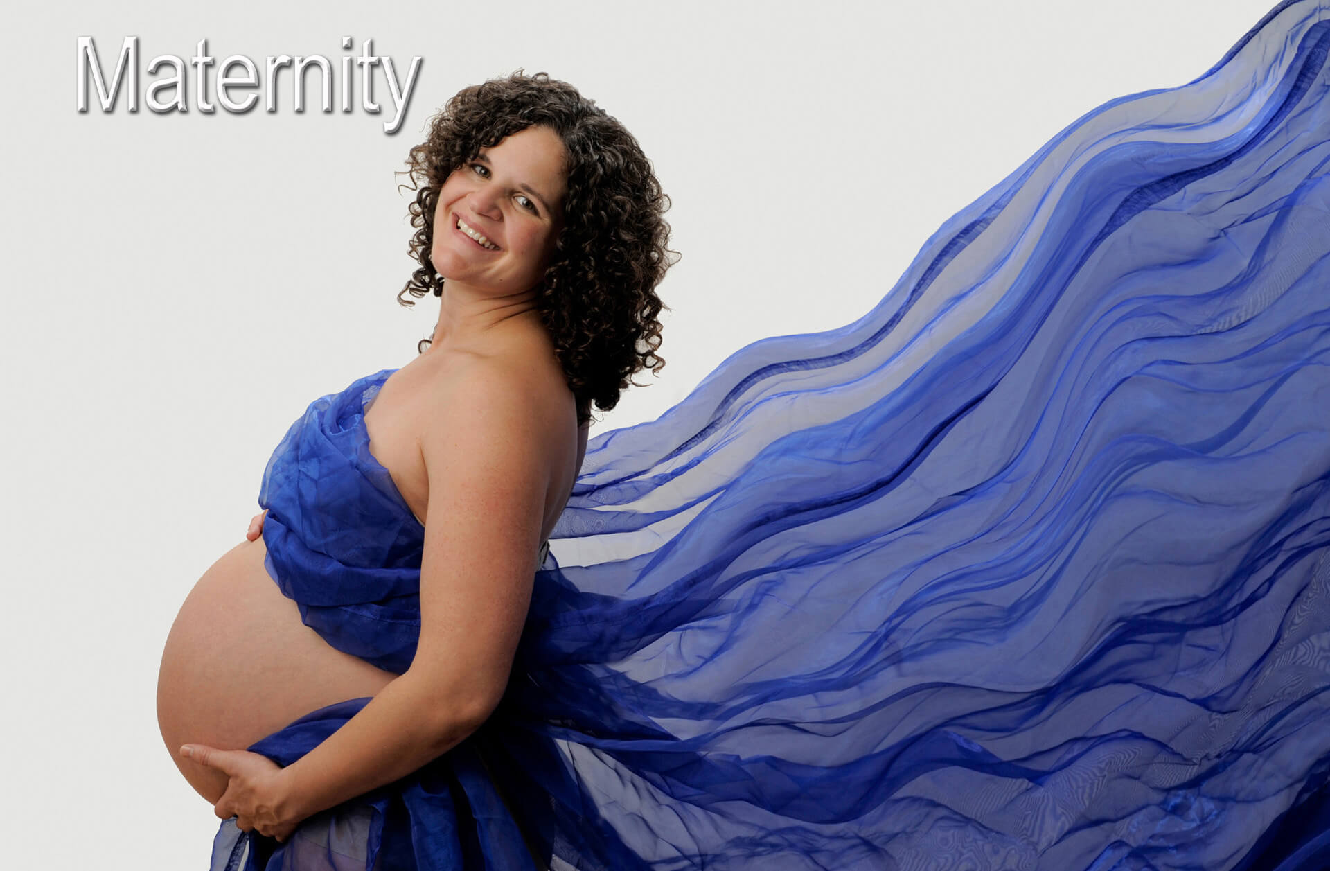 Voted best and favorite maternity photography by my clients, Marci Curtis features maternity photos photographed in creative ways either on location or in her studio in Troy, Michigan area.