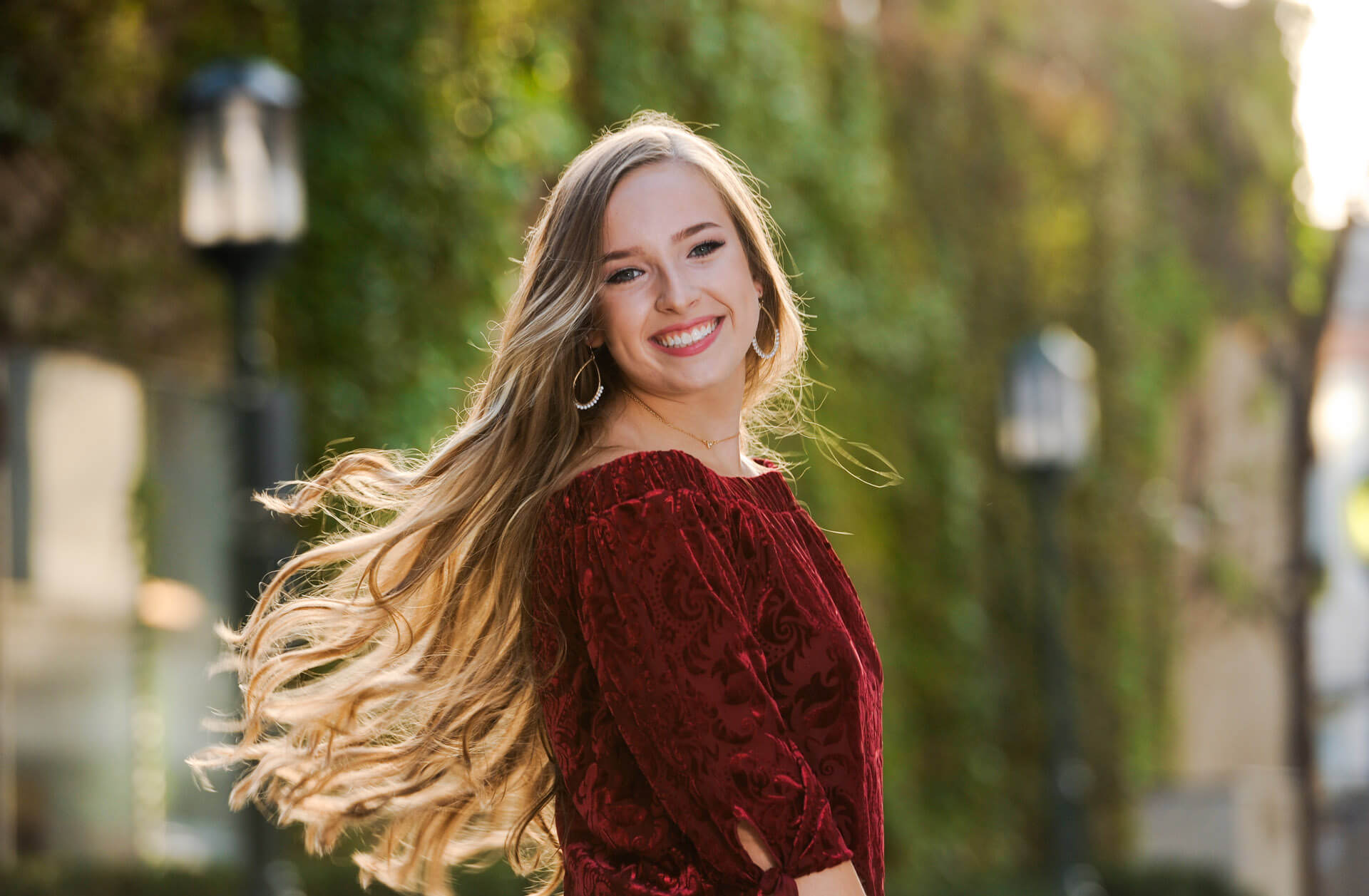 A senior strolls down the stets of Birmingham, Michigan for her high school senior photos.