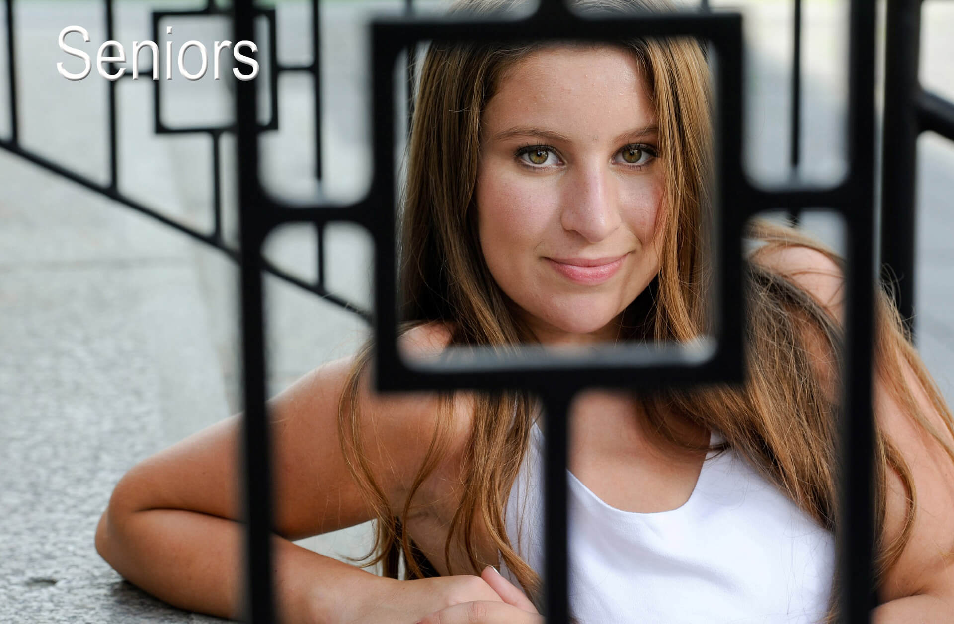 A Clarkston, Michigan senior poses for this dramatic senior photo in Birmingham, Michigan.