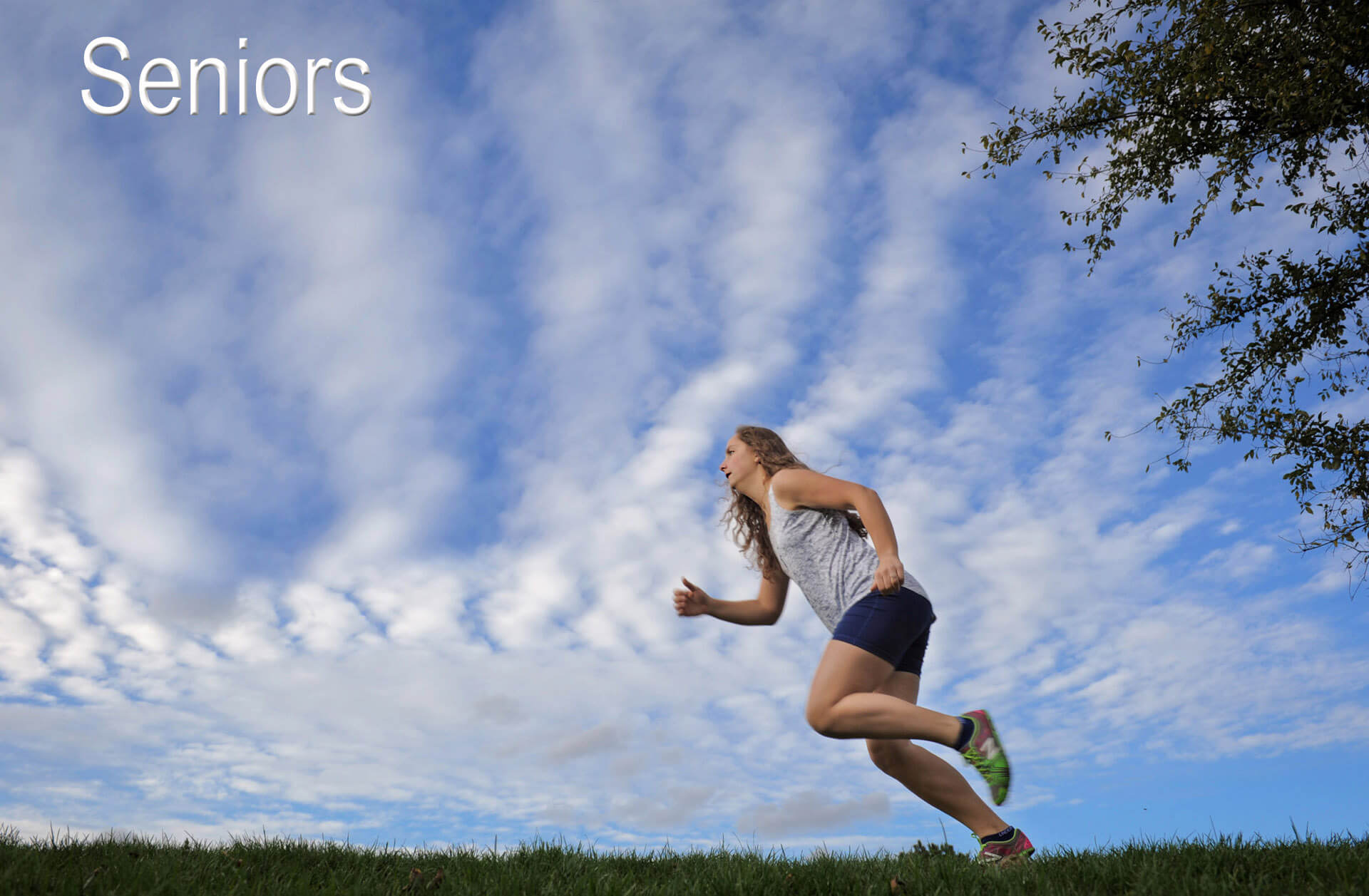 A Farmington Hills Michigan senior practices cross country for her high school senior photos in Farmington, Michigan.