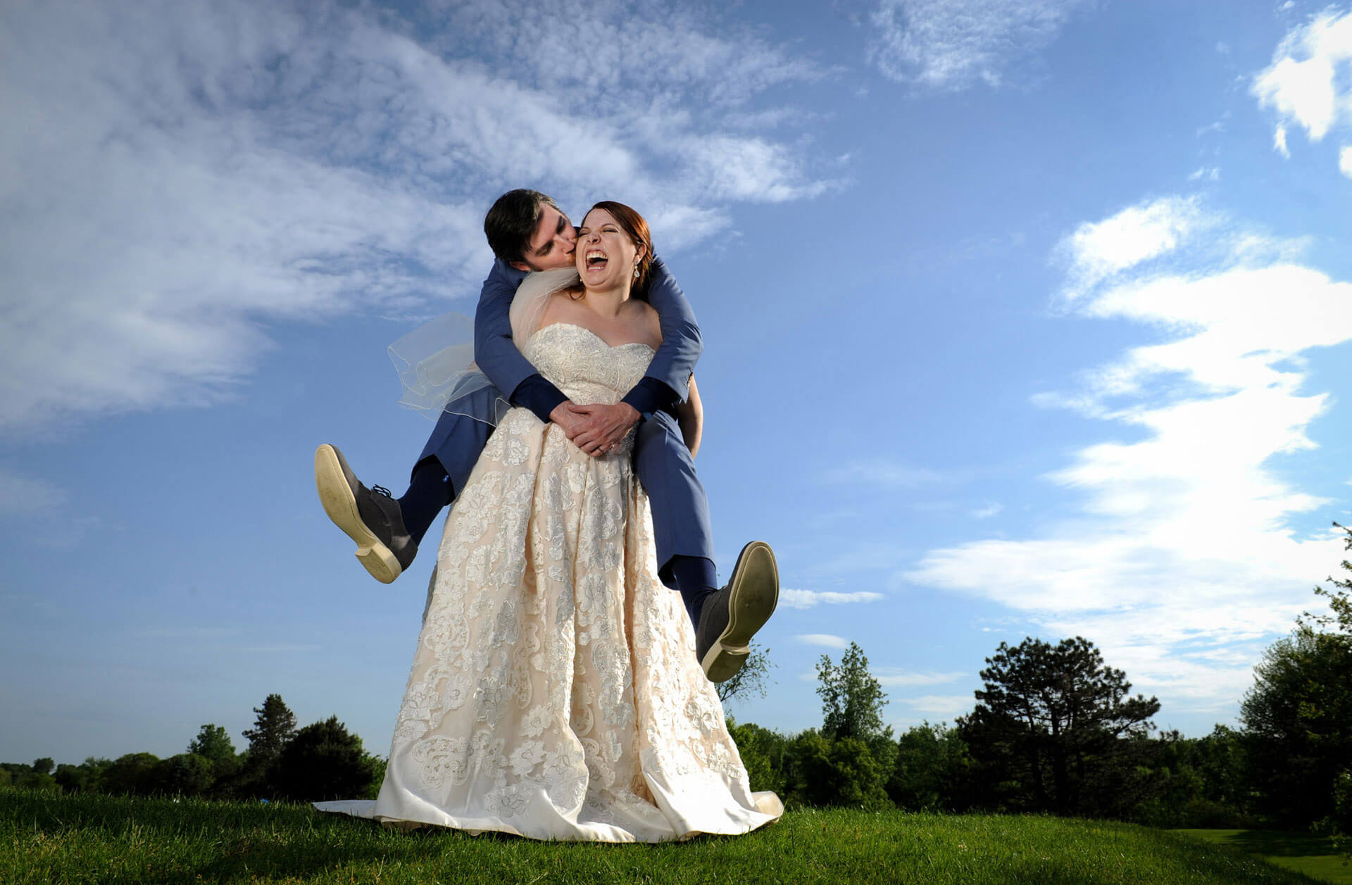 Fun, candid wedding photojournalism is what this award winning photojournalist brings to shooting Ann Arbor weddings.