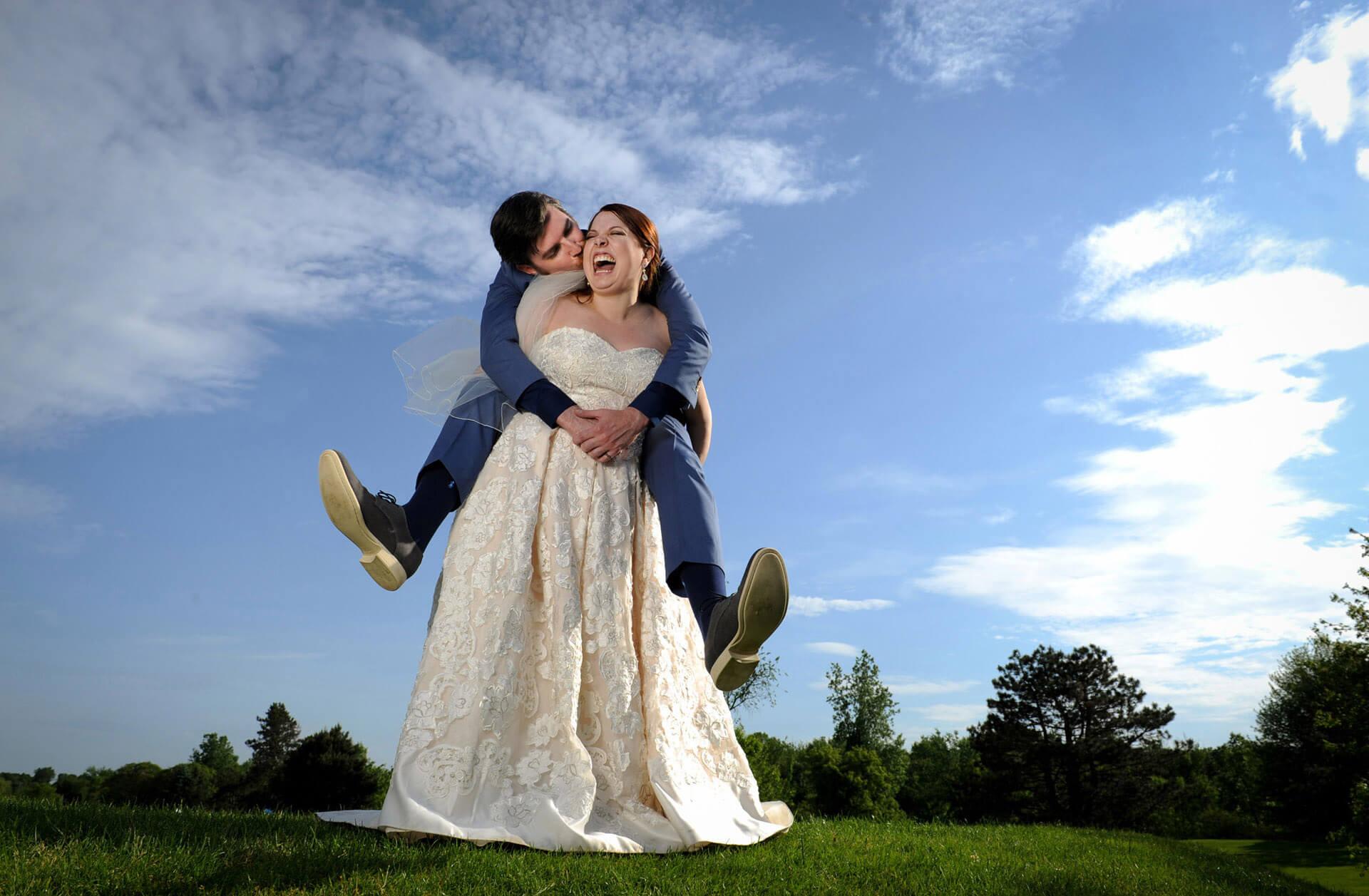 Fun, candid wedding photojournalism is what this award winning photojournalist brings to shooting Ann Arbor weddings like this White Oaks wedding.