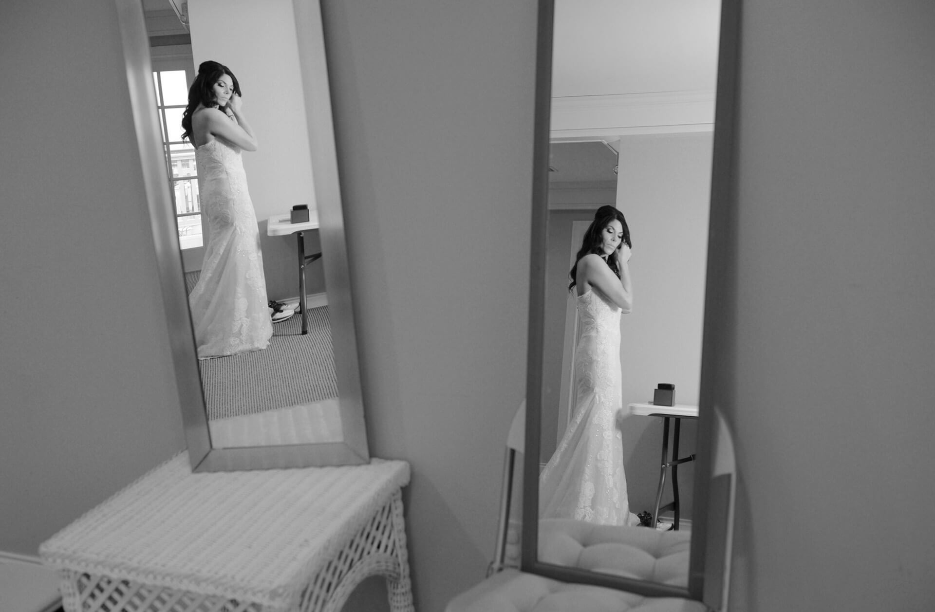 A Grosse Pointe Michigan bride gets ready at the Grosse Pointe Pier in Michigan.