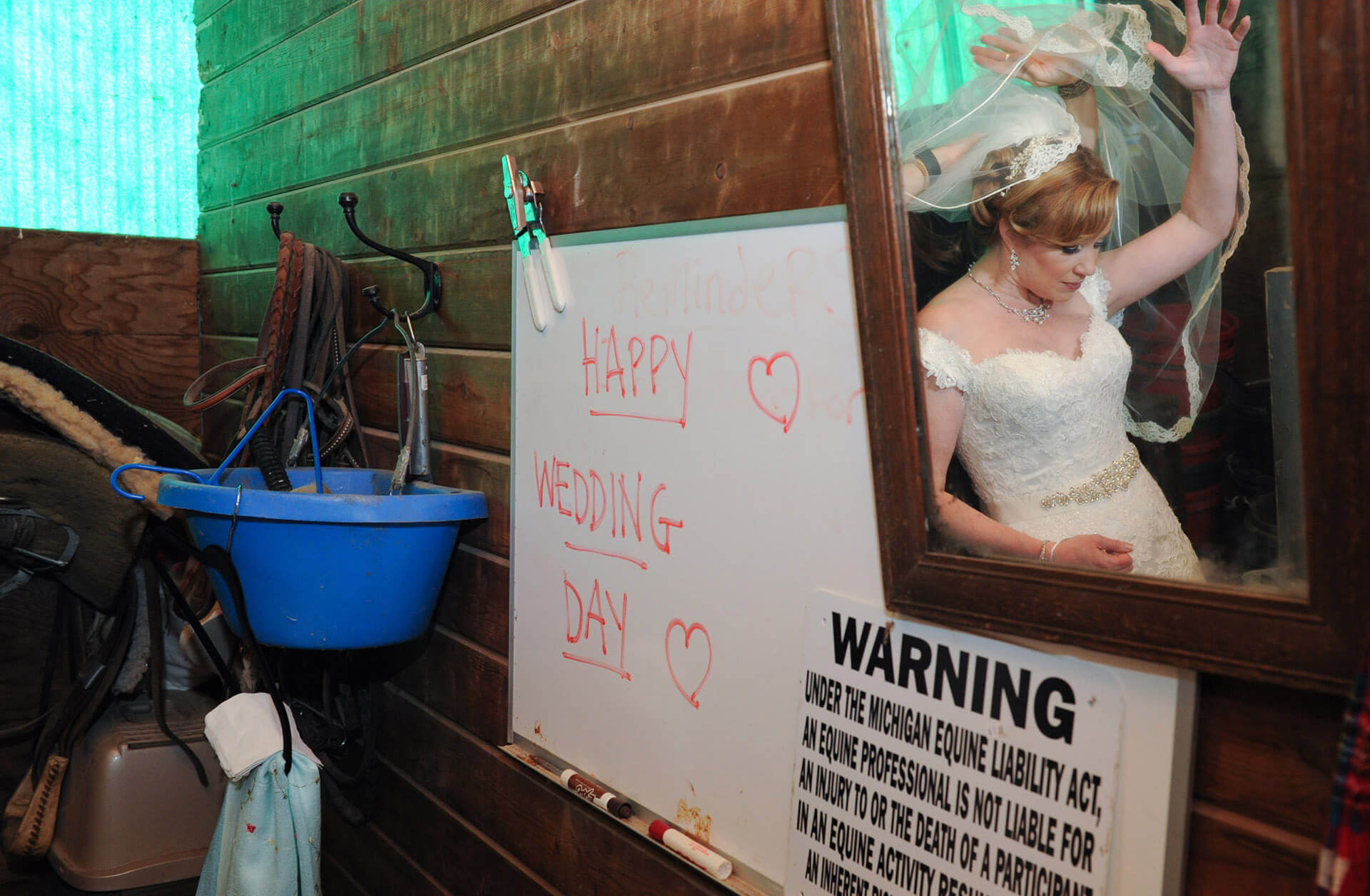 Bride gets ready in a horse stall before her amazingly elegant wedding at the Red Ridinghood Stable in Holly, Michigan.