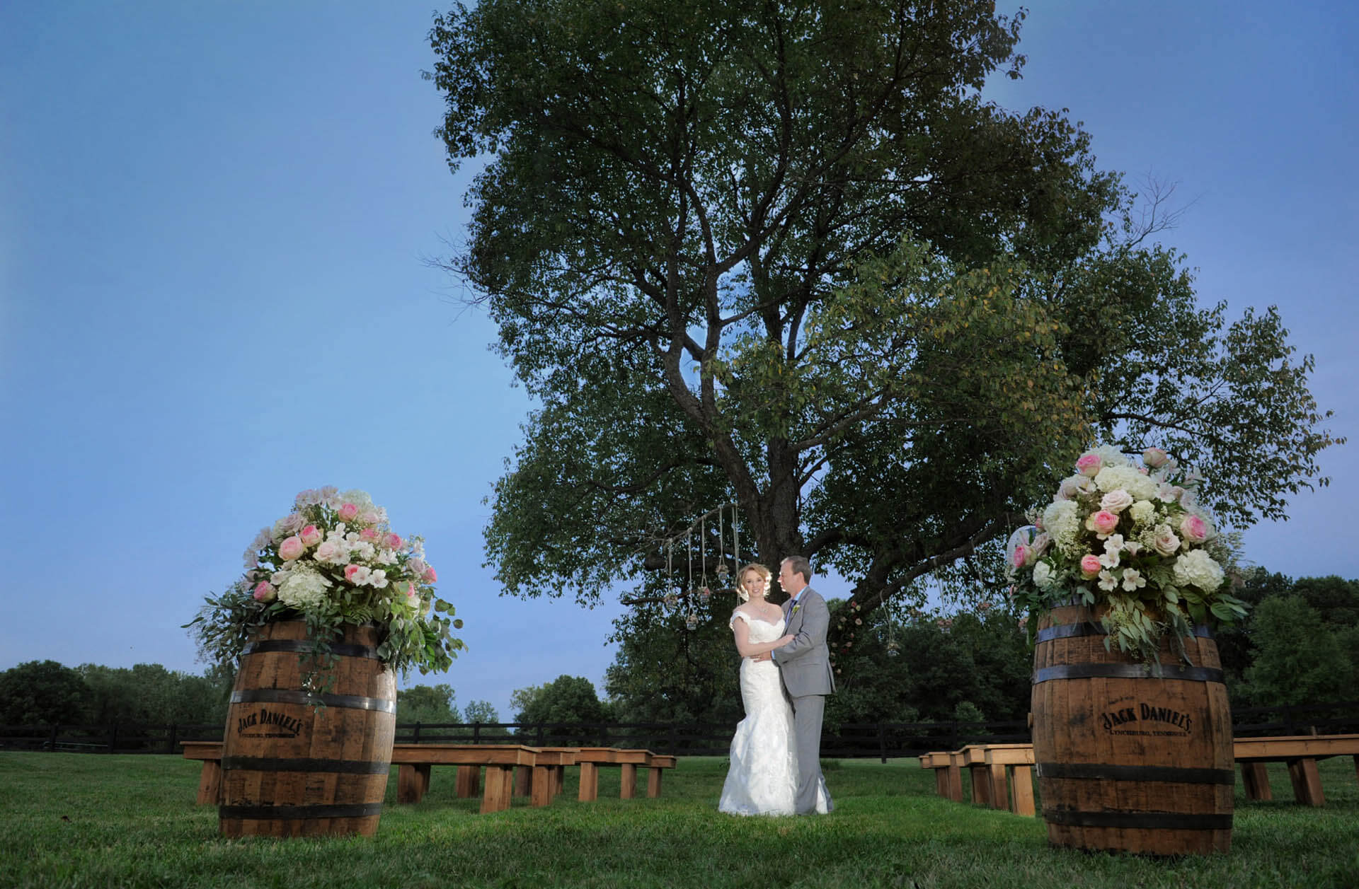 The bride and groom pose after their barn wedding at the Holly Hotel in Holly, Michigan.
