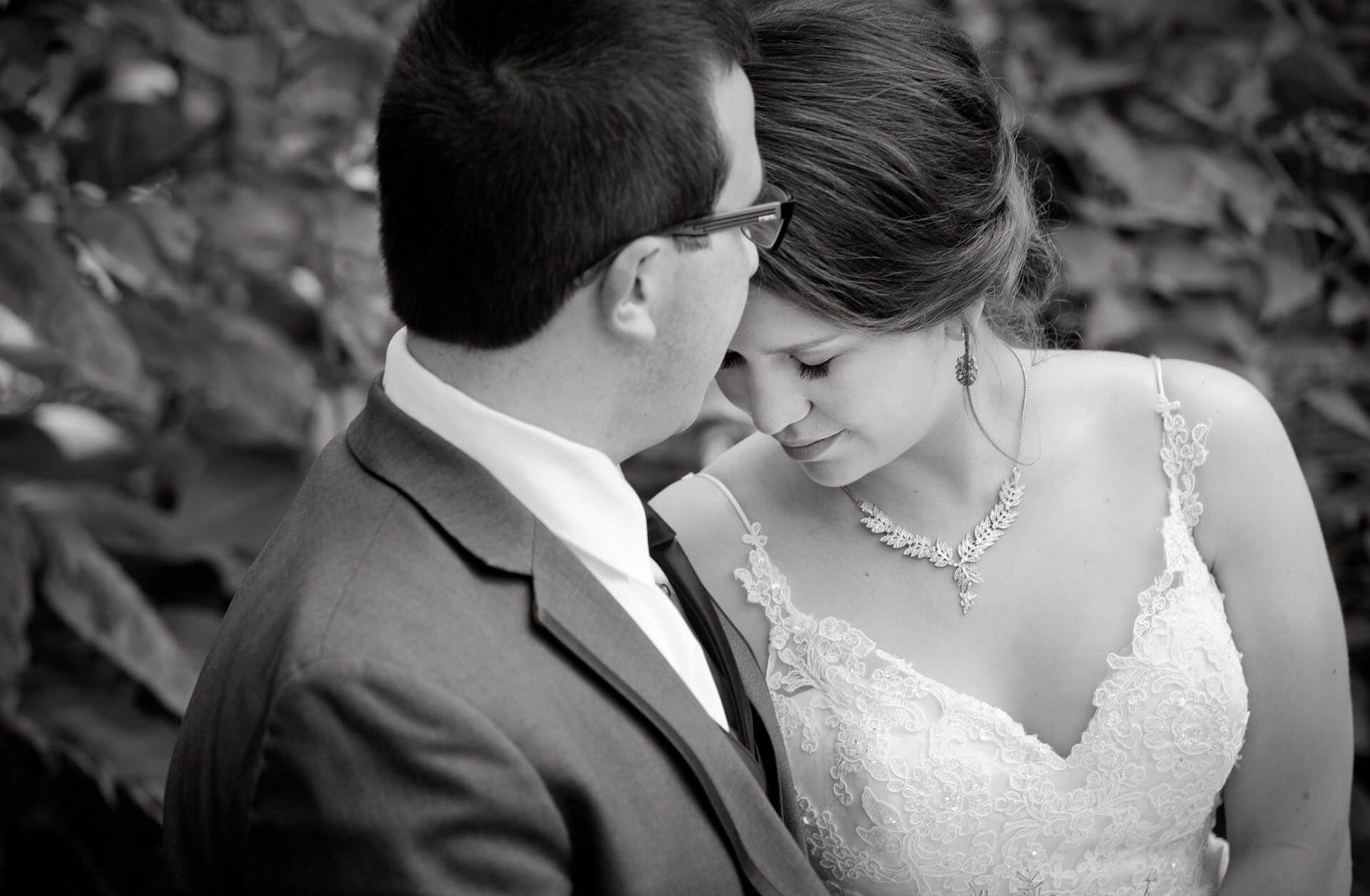 A bride and groom nuzzle before their Saline, Michigan wedding at Wellers for this intimate portrait.
