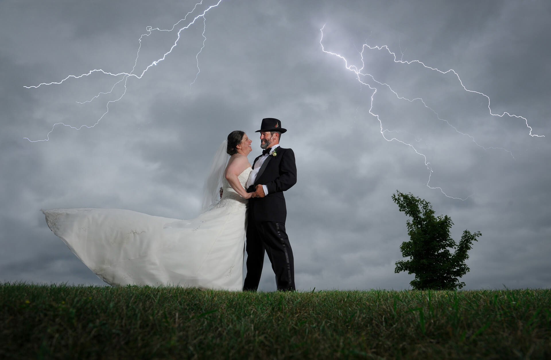 The bride and groom dance in the gathering storm at the Indian Springs Metropark in White Lake, Michigan.