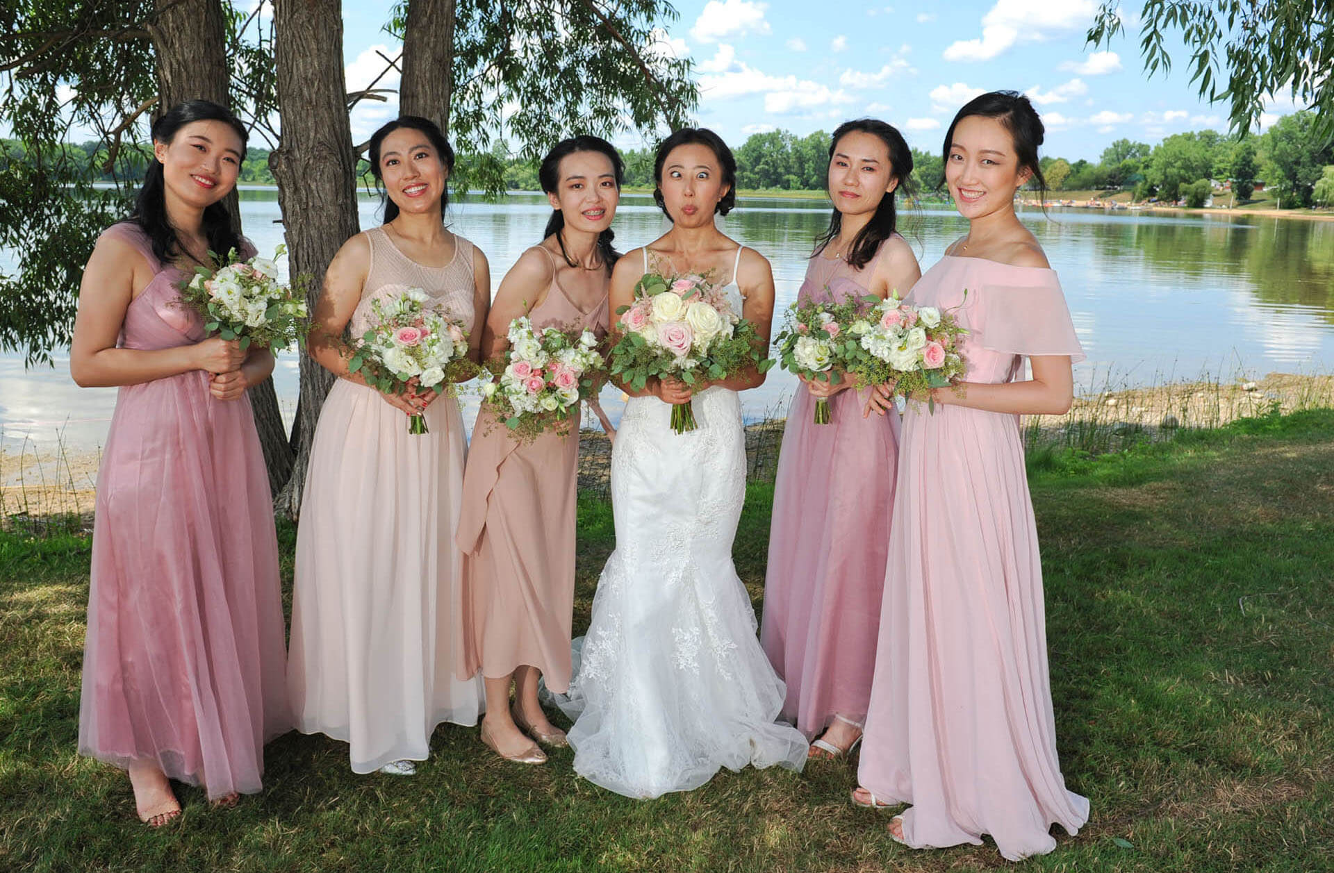 The bride played a prank on her bridesmaids while taking formal wedding photos at the Waldenwoods Resort in Hartland, Michigan.