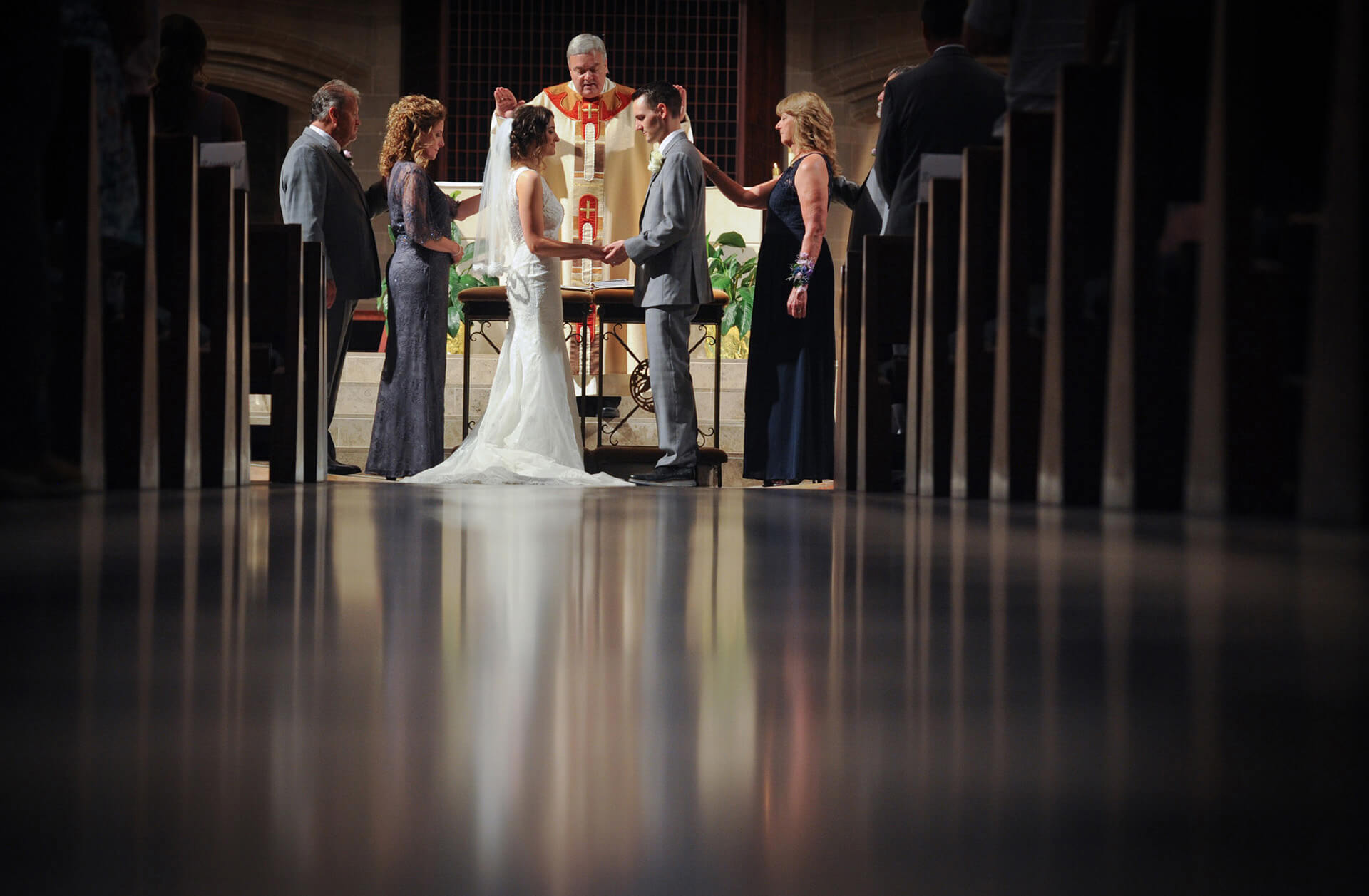 The bride and groom receive blessings from their families during their downtown Detroit, Michigan wedding ceremony.