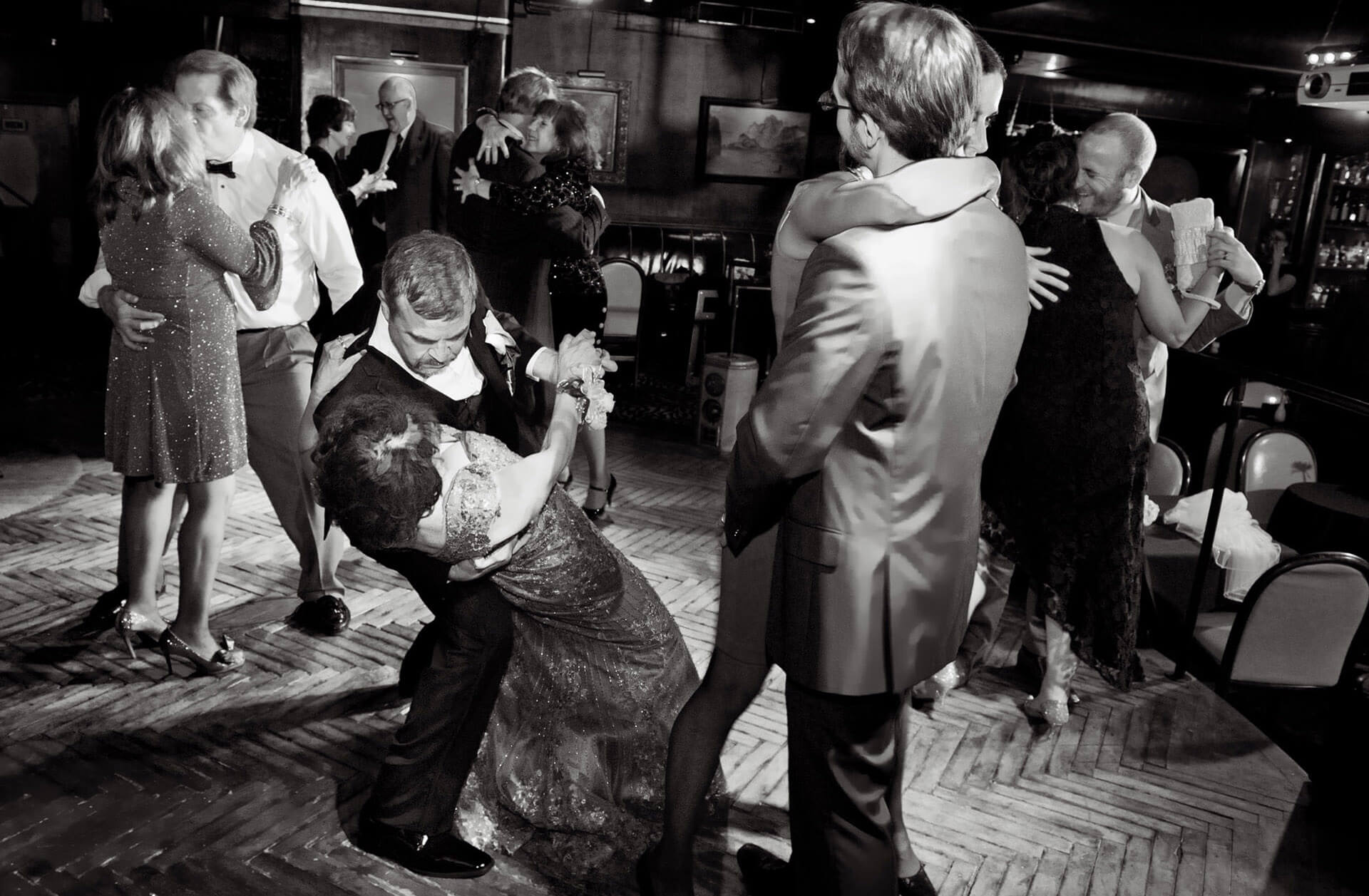 The dance floor is open and packed at Cliff Bells for an intimate jazz themed wedding in downtown Detroit, Michigan.