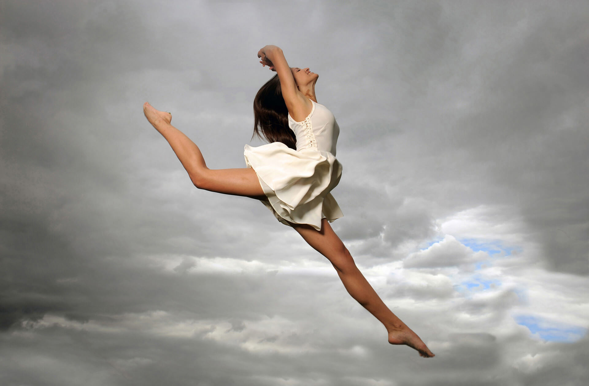 A Troy, Michigan senior leaps into the air for her senior photos.