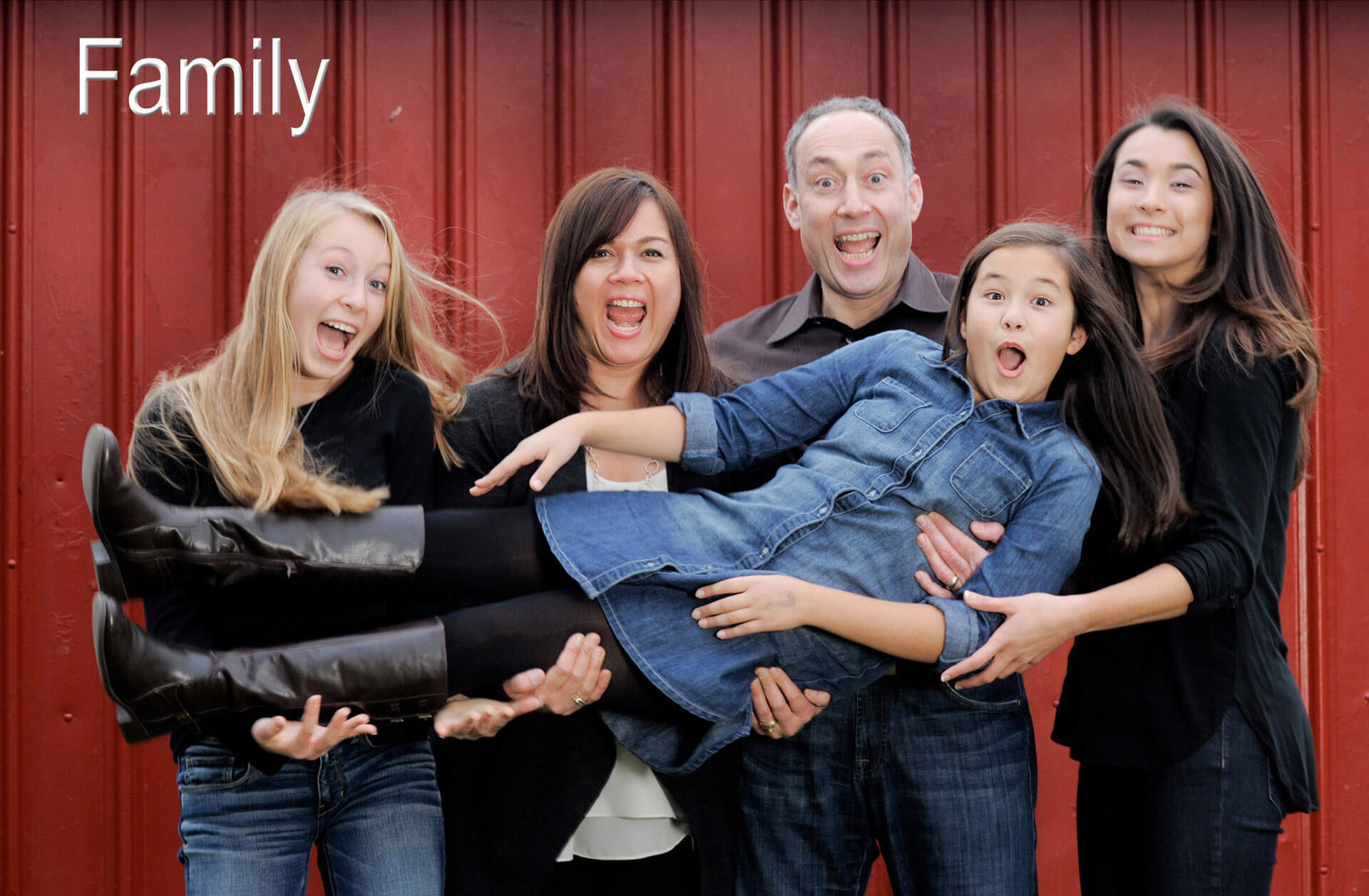 In a fun family photo, one family member is left out of this Detroit area family photo using her favorite Michigan photojournalist background to capture fun, family candid photography.