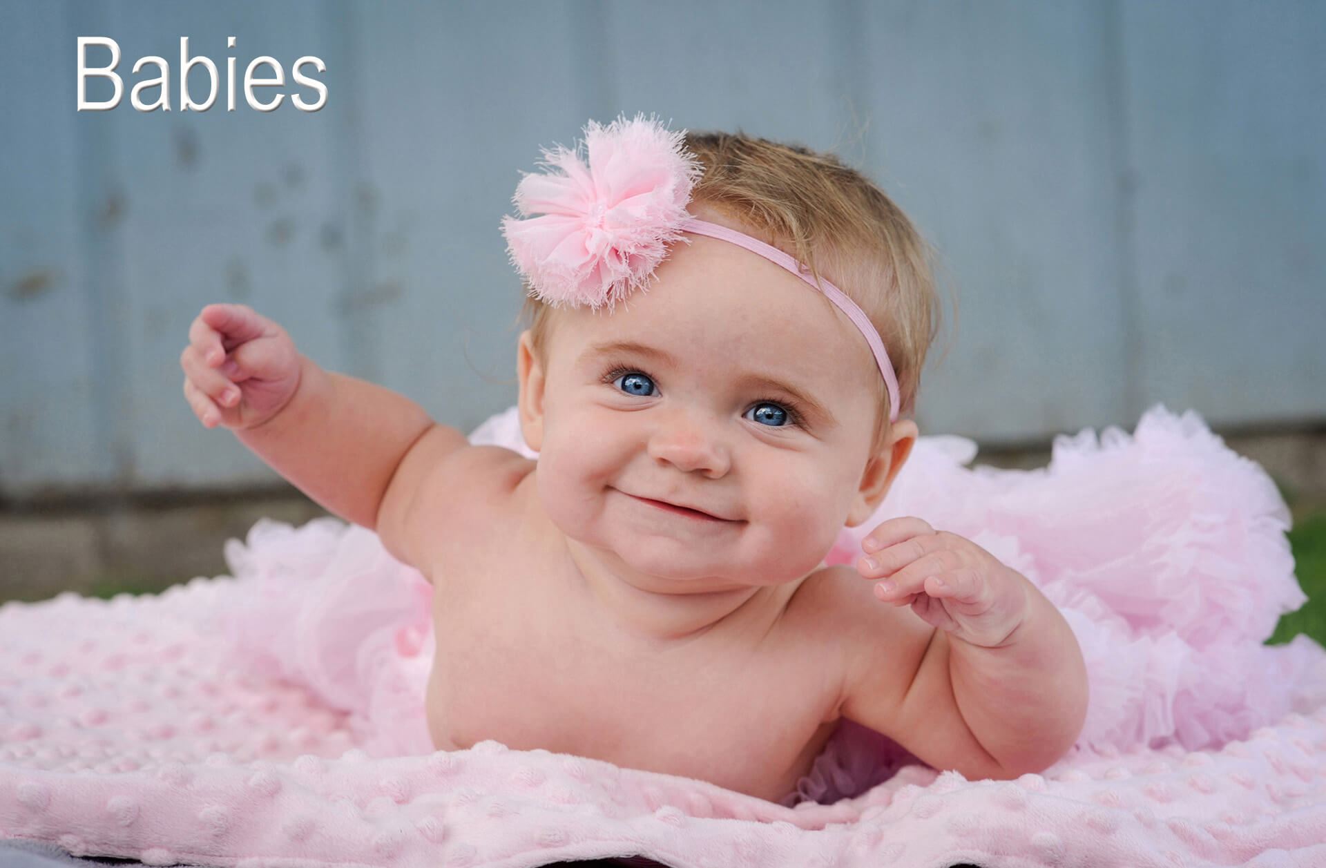 A little girl's sixth month photo shoot features a baby in Troy, Michigan in her tutu during best baby photographer Marci Curtis's Detroit baby photography session.