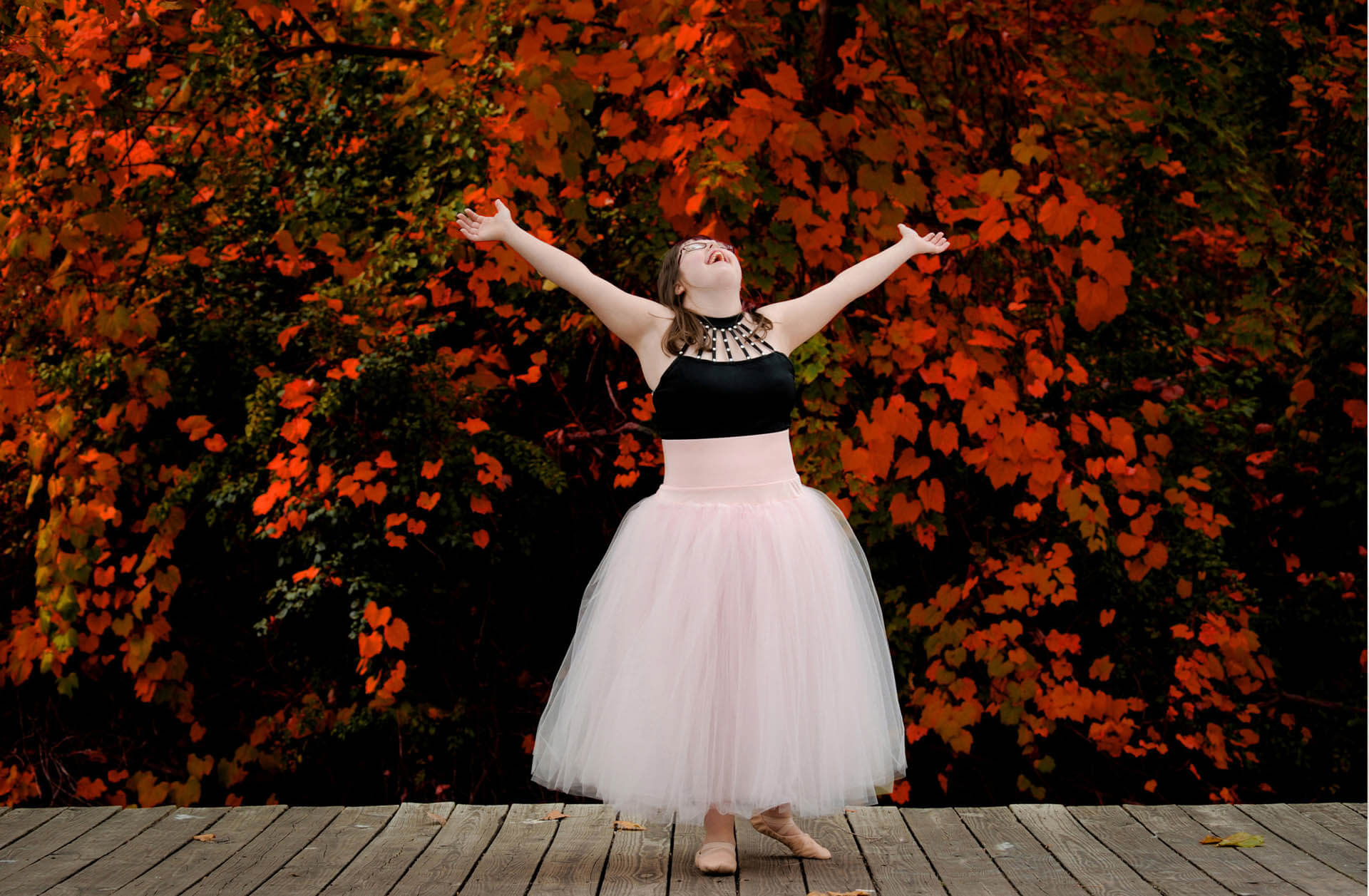 A metro Detroit, Michigan special needs senior dances with joy during her senior photo shoot.