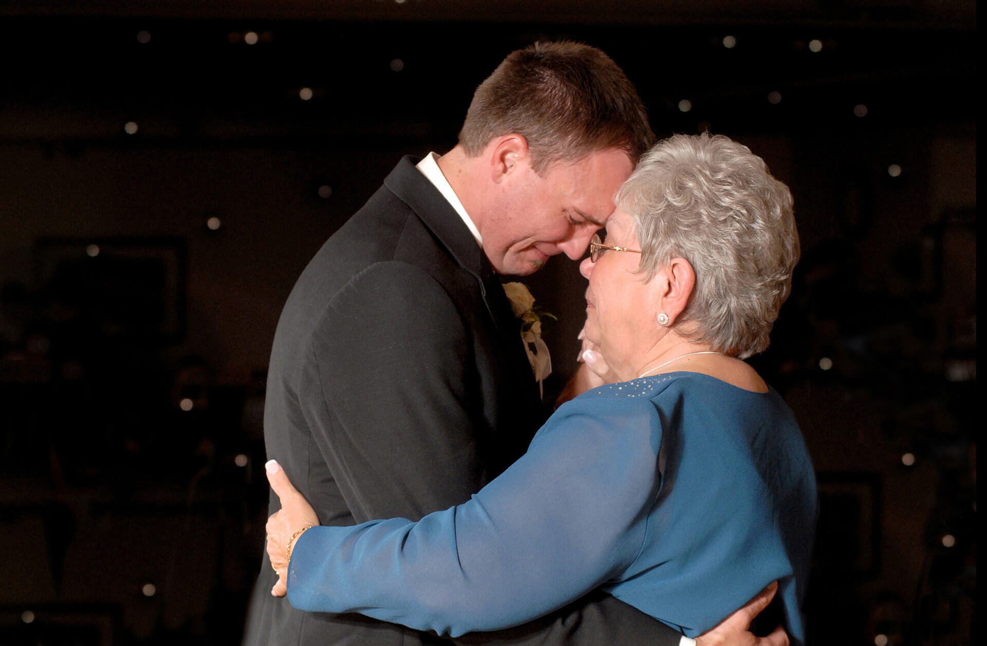 A Lake Orion, Michigan groom cries as he dances with his mother at his wedding.