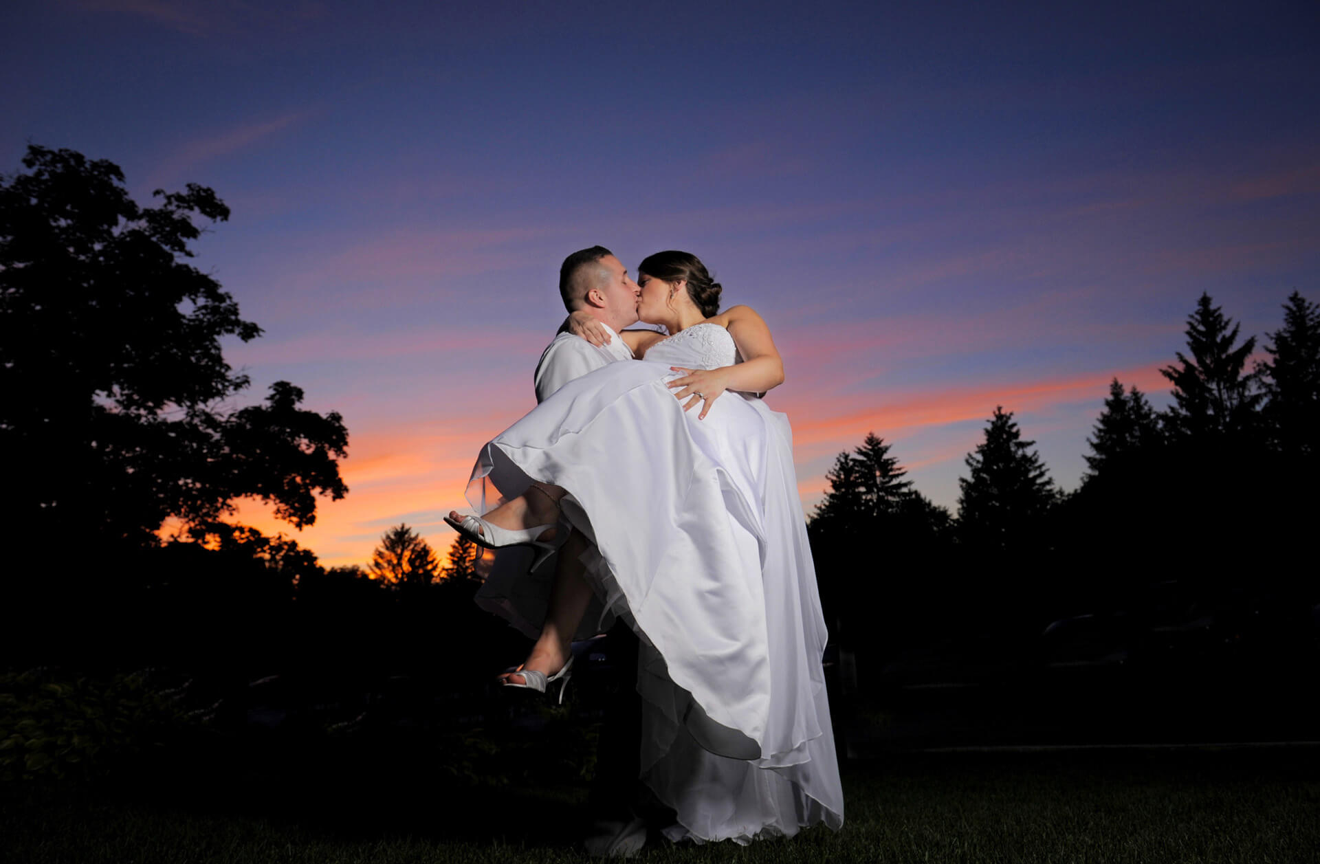 A Macomb County, Michigan wedding at Tina's Country House just before darkness and a storm hit.