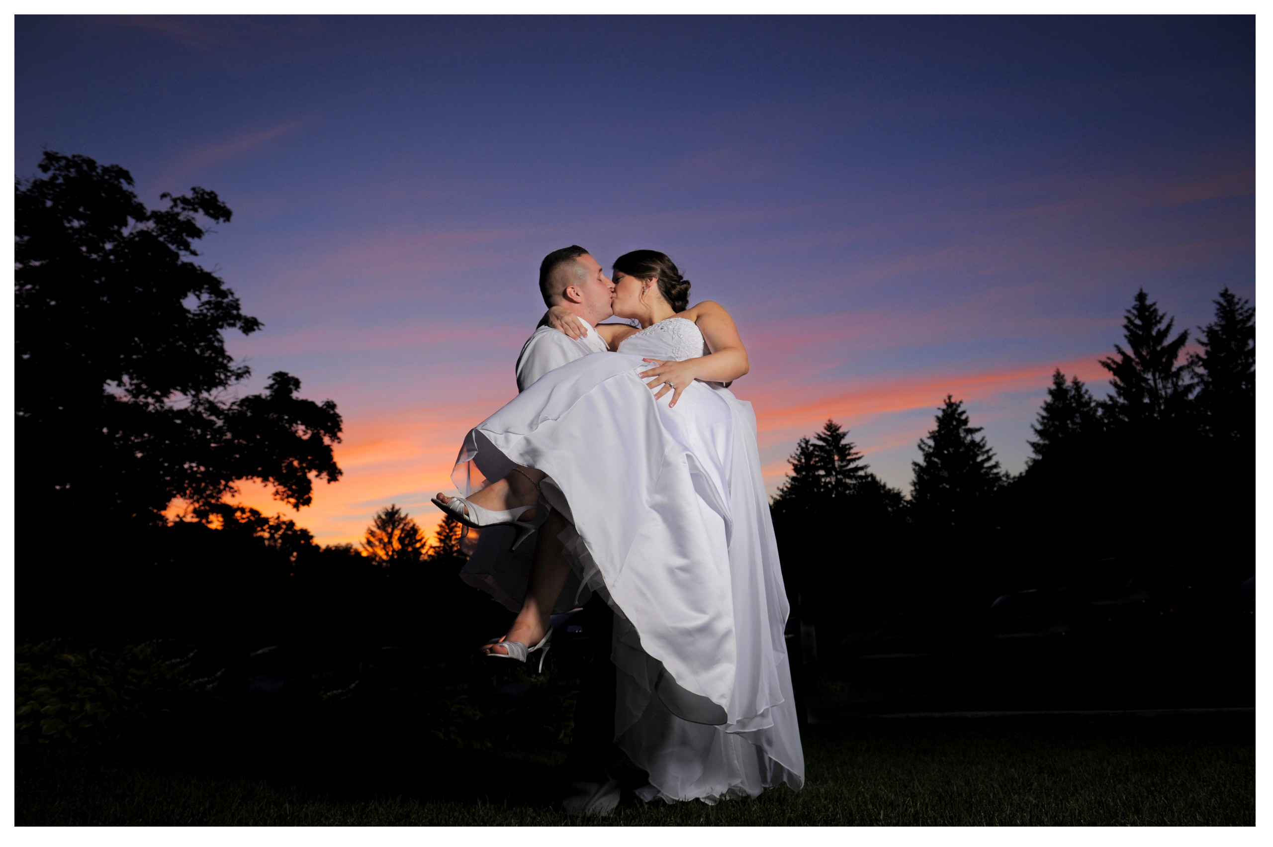 A Clarkston, Michigan wedding at The Carriage House just before darkness and a storm hit.
