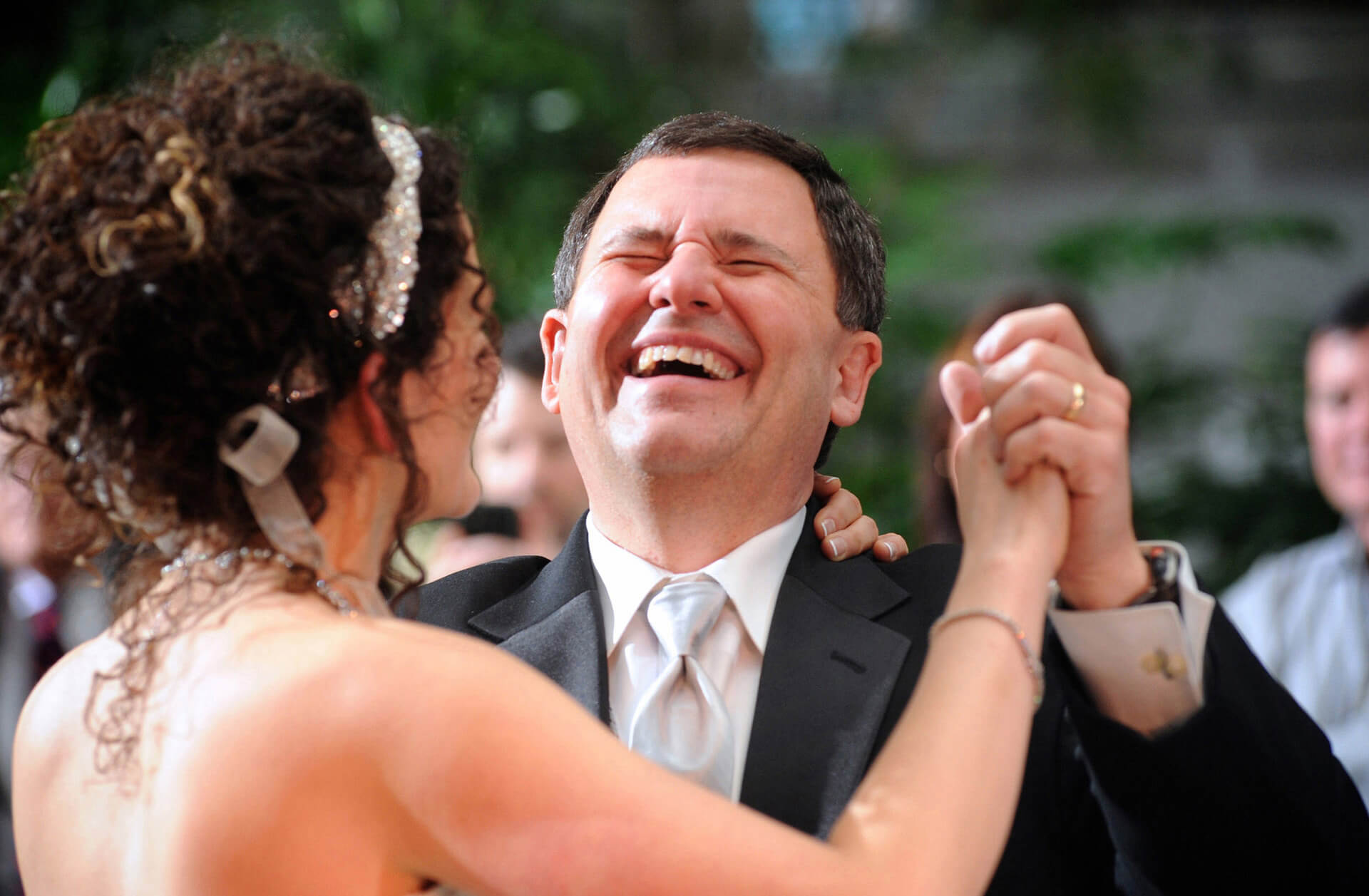 A Metro Detroit Michigan bride dances with her father and he reacts while dancing with his daughter in Southfield, Michigan.