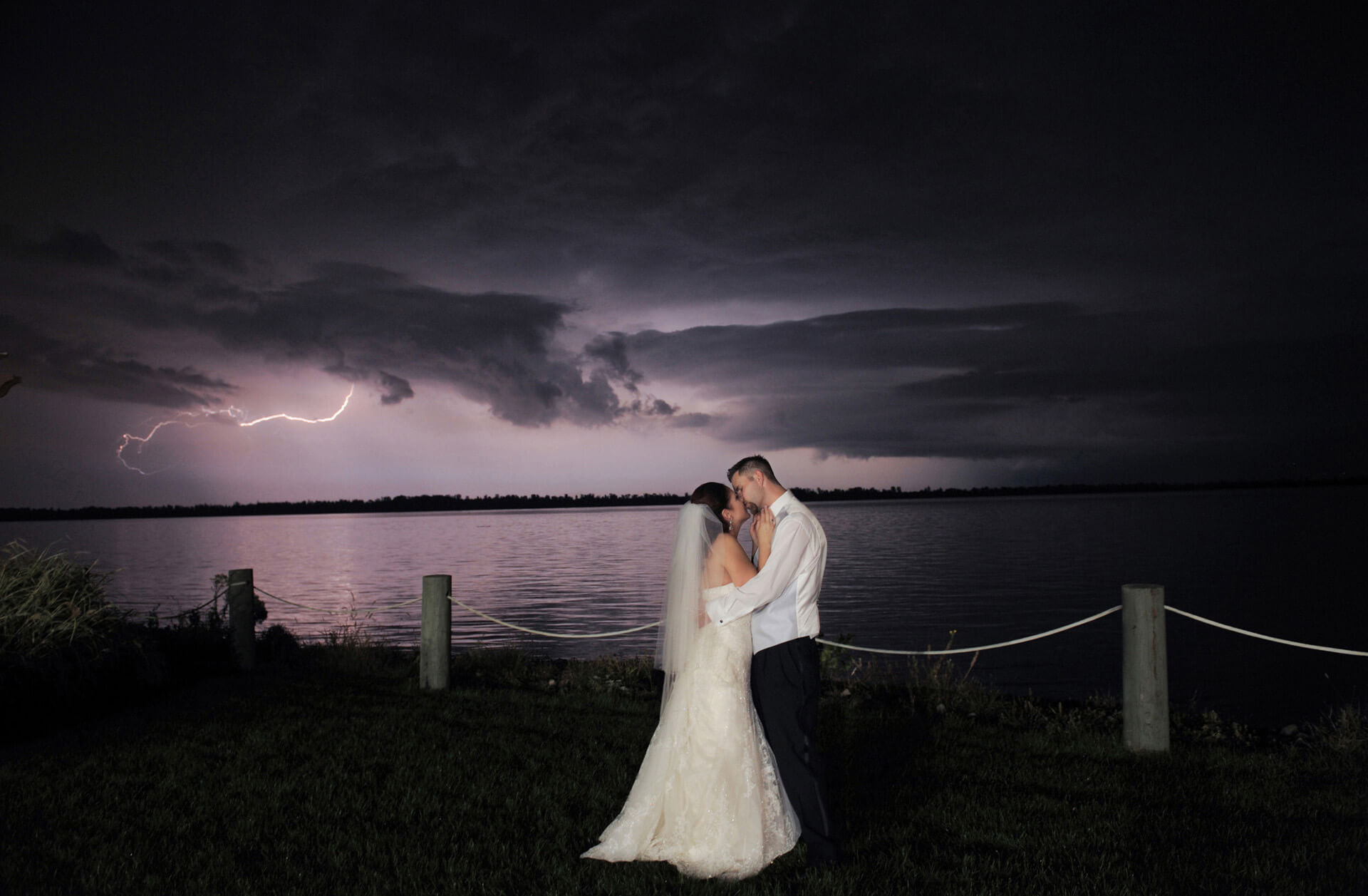 Creating and capitalizing on incredible moments, like this lightening strike during a wedding on the Detroit River is part of what makes me the best, most popular wedding photographer in Detroit, Michigan.