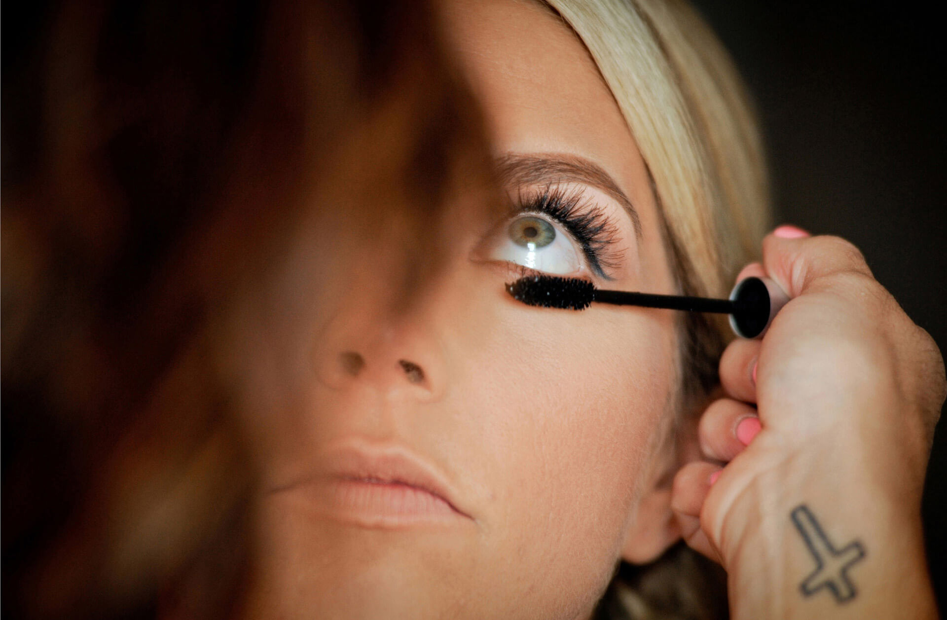 Detroit bride concentrates on having her make up done before her Detroit, Michigan wedding.