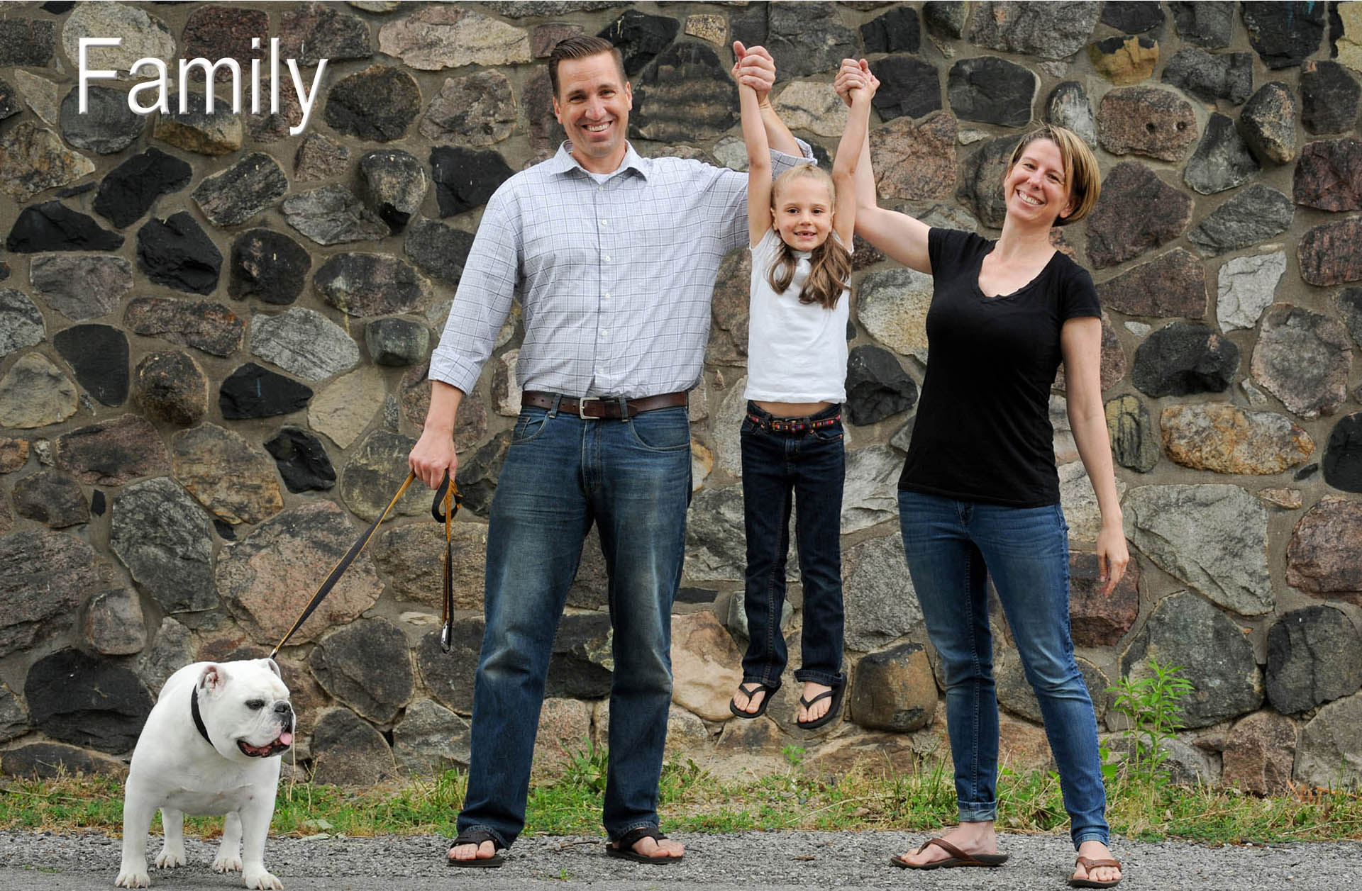 A metro Detroit area couple celebrate the arrival of their adopted daughter with a fun, happy family photo downtown Detroit, Michigan.