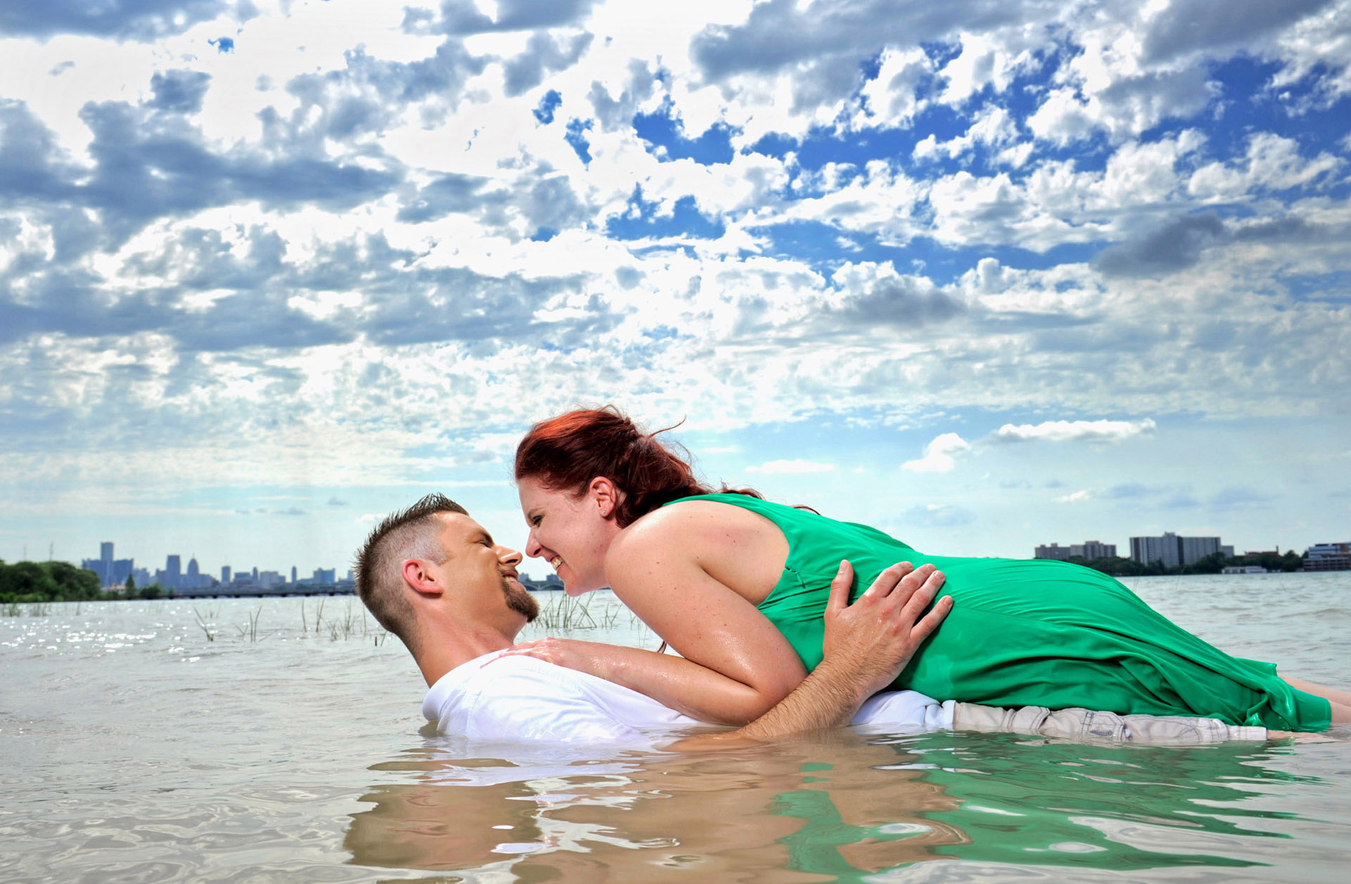 Marci Curtis Detroit engagement photographer photographs her wedding couples in places that are different and that mean something to the couple, like this couple photographed in the Detroit River in Detroit, Michigan.