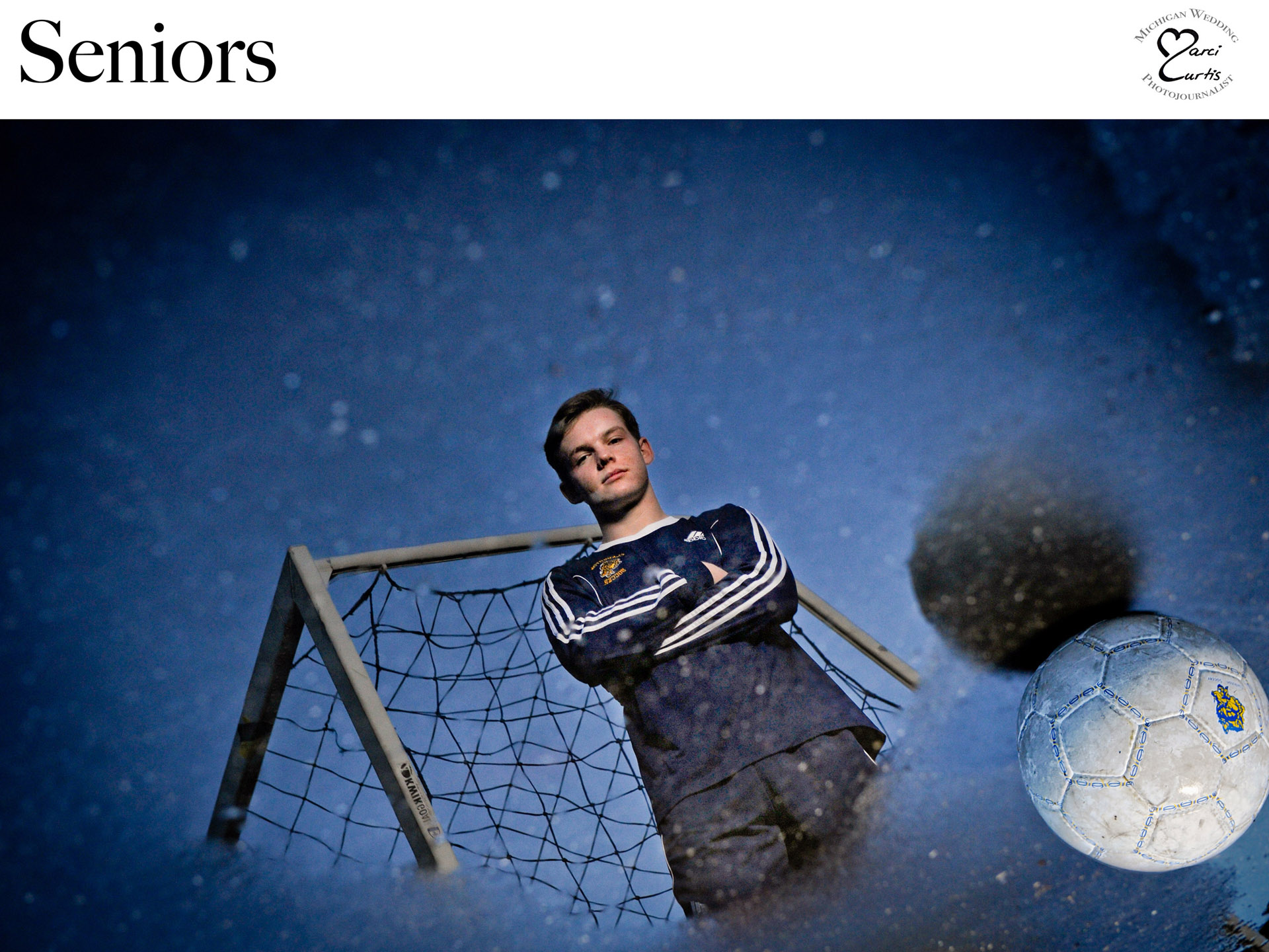 A Clarkston Michigan high school soccer playing senior is reflected in a puddle for this one of a kind senior photo featuring Marci Curtis's best Metro Detroit senior photos.