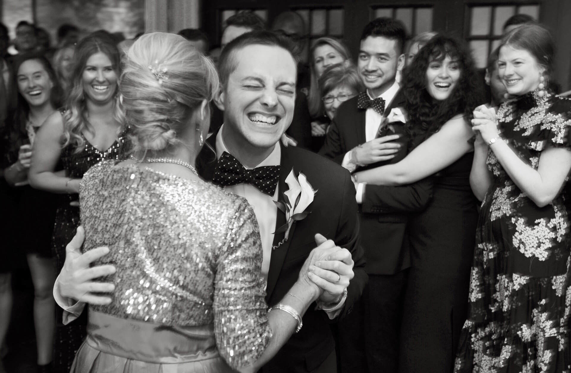 Fun, candid wedding photojournalism moments like this mother and son dance is what being able to capture spontaneous moments from weddings is what sets me apart from other wedding photographers.