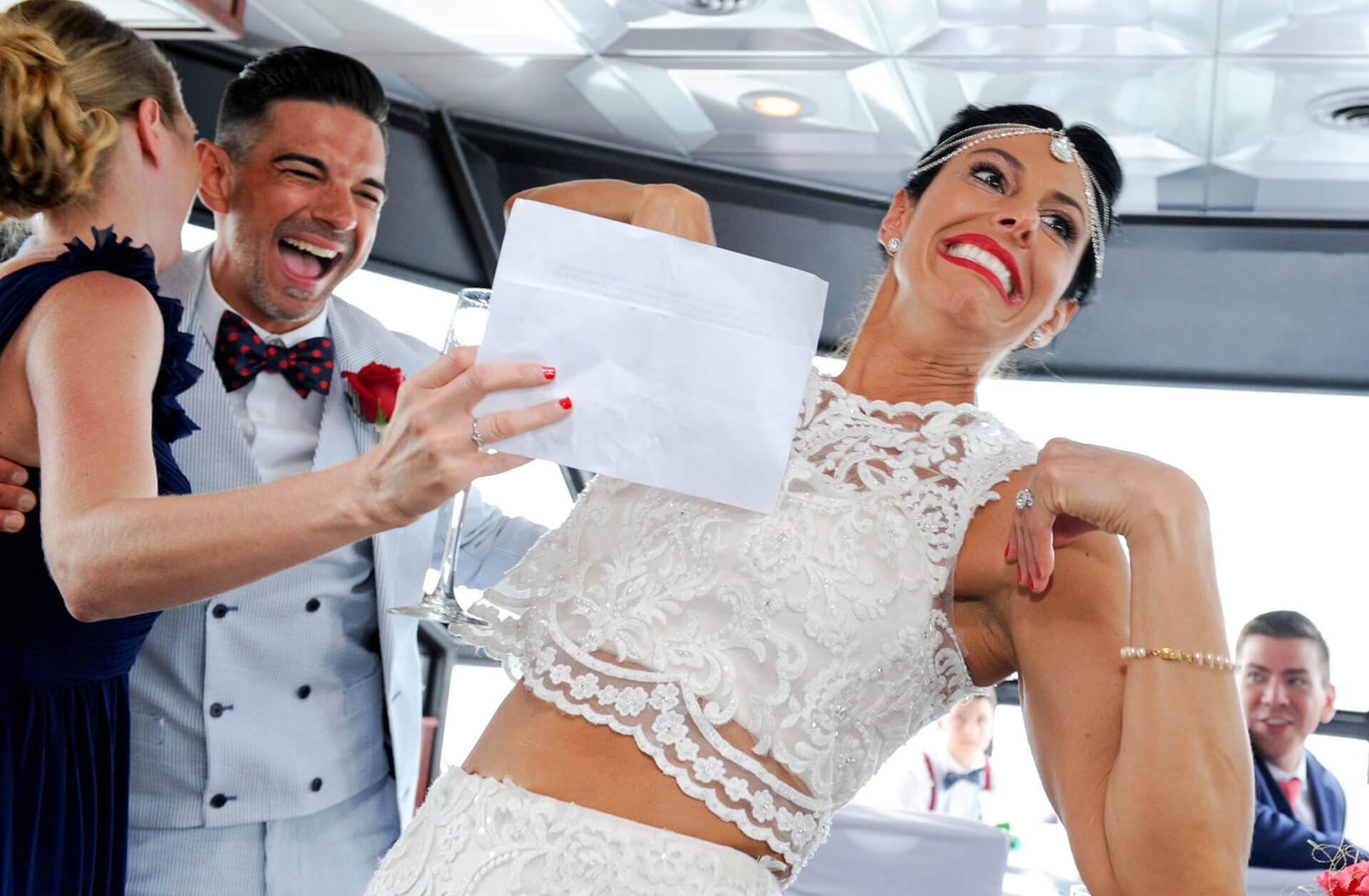 The bride and groom have a slight wardrobe malfunction while aboard their Infinity and Ovation Yacht wedding in Michigan.